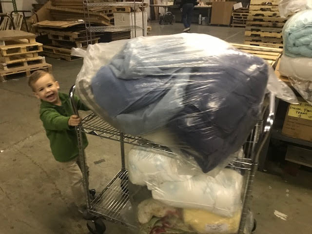 This youngster showed that with the right equipment anybody can load a truck! This bedding put the finishing touch on one of our deliveries of essential furniture, helping to turn basic shelter into a home.