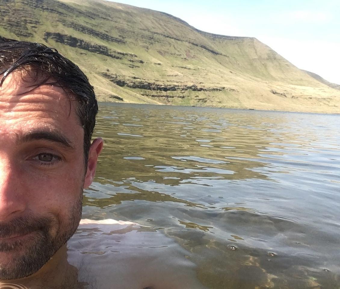 Going for a short but refreshing swim in Llyn y Fan Fawr