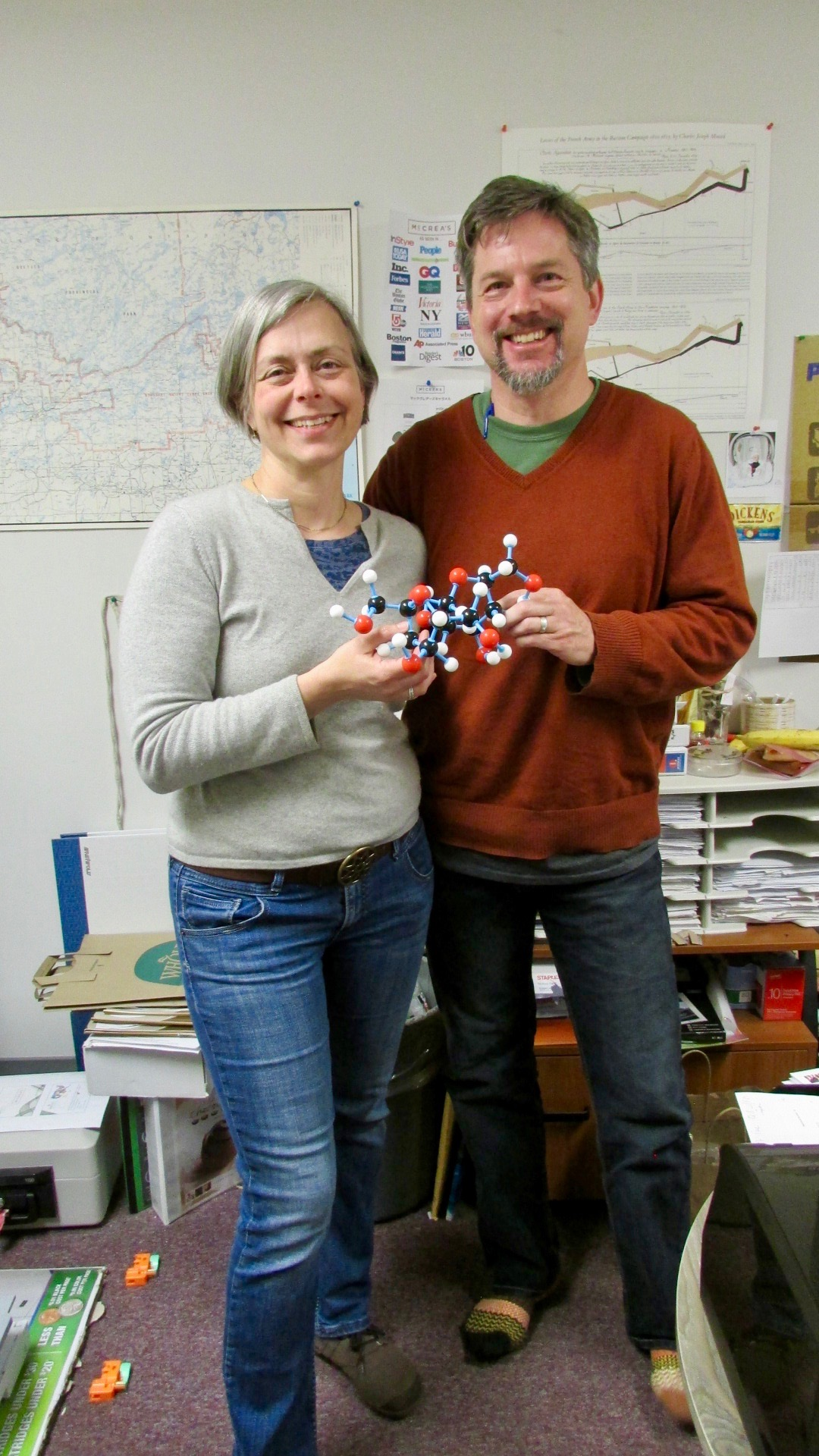 Wife and Husband Team: Kate and Jason McCrea Holding a Sugar Molecule