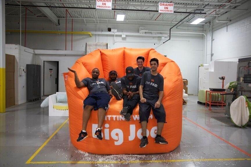 Ambassadors sitting with Big Joe. Photo courtesy of Comfort Research.