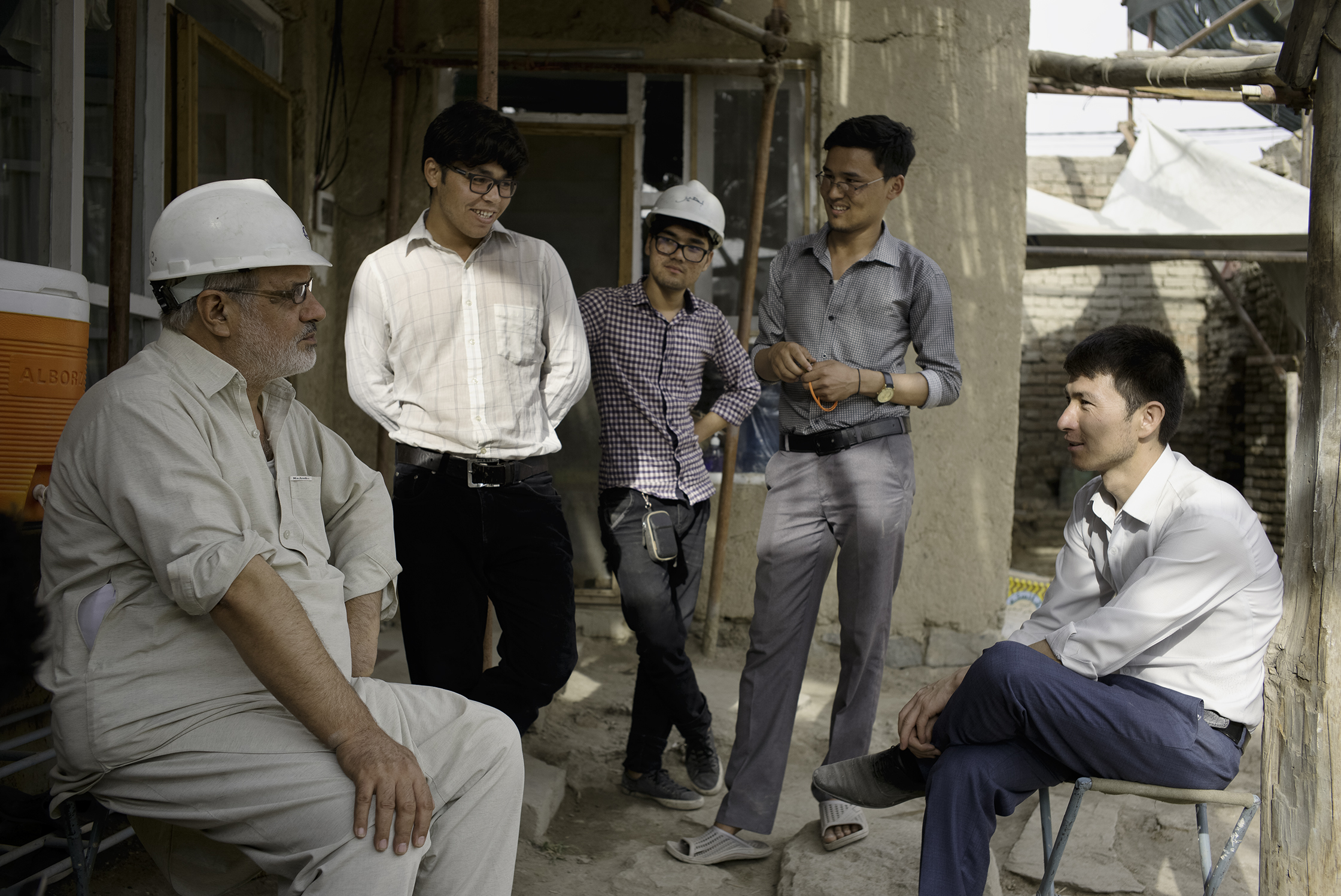 Project Director Abdul Wasay Najimi, left, speaks with Kabul University architecture students on the urgent need for preserving Kabul's heritage amid the city's chaotic growth.