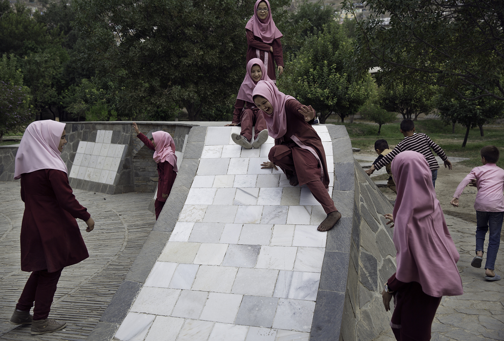 Youth   are among the tens of thousands of visitors who find a reprieve from the noise of Kabul in Bagh-e Babur considered to be among the finest surviving examples of Mughal garden design.