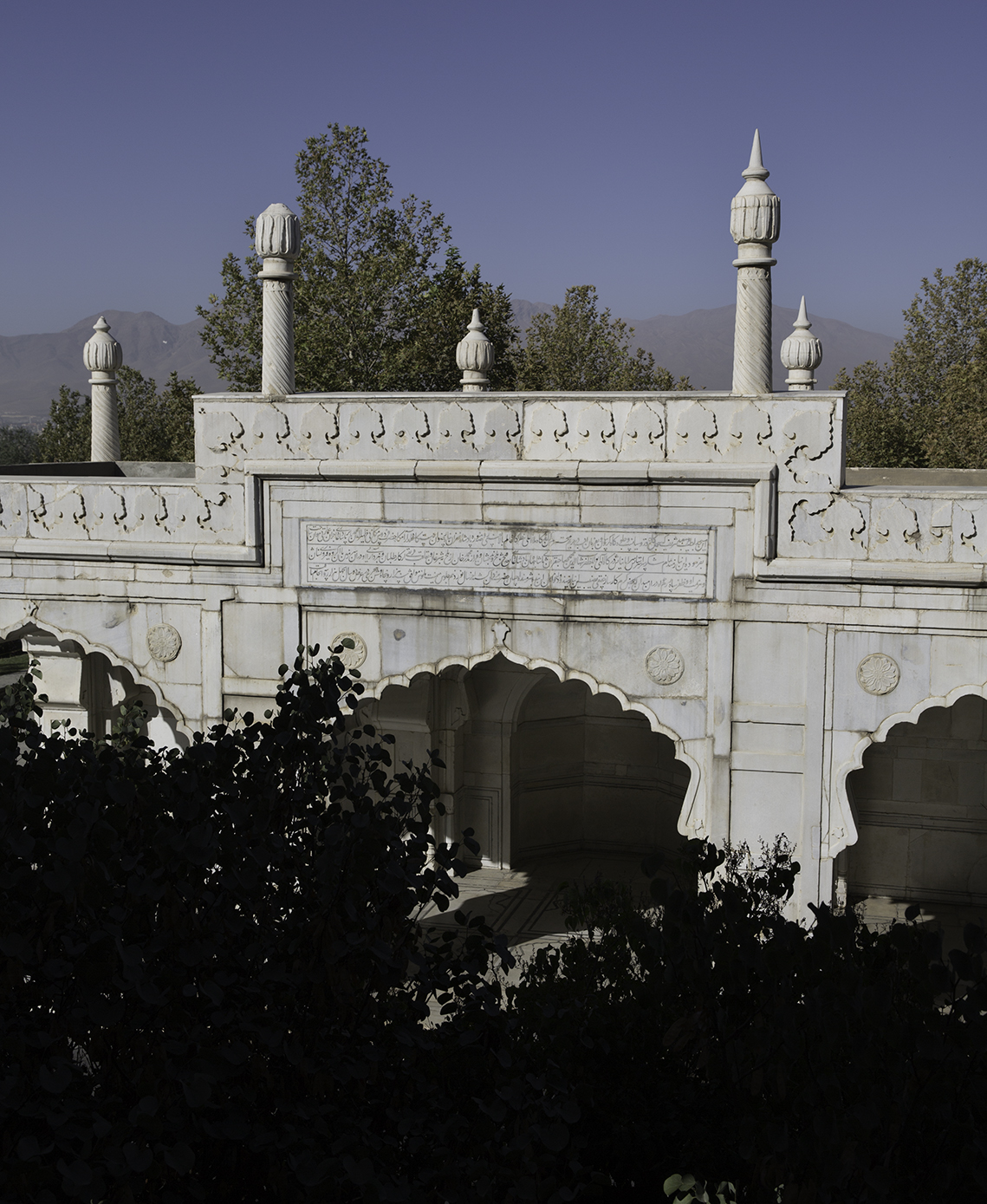 The front view in Bagh-e Babur of a small white marble mosque built in 1647 by Mughal ruler Shah Jahan.