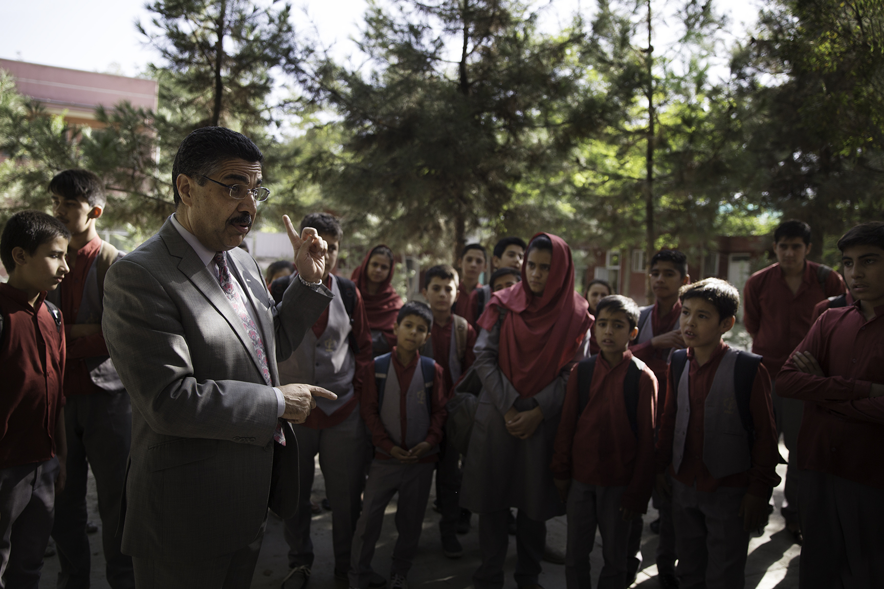 Dr. Ahmad Sarmast (left), Director of the Afghan National Institute of Music, warns students to take security precautions in the wake of a suicide attack in the downtown area of Kabul.