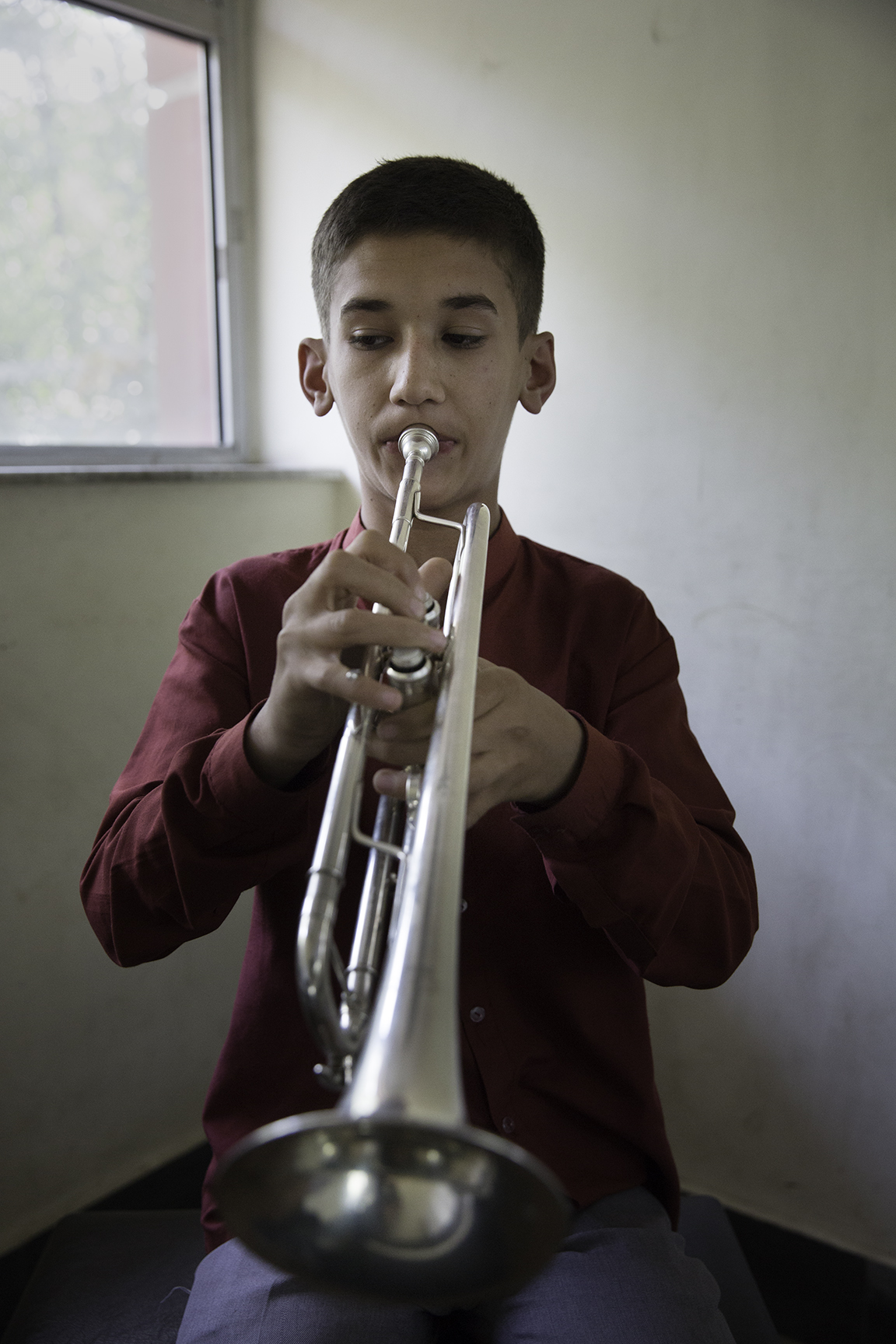 A trumpeter practices his notes in one of the school's studios.