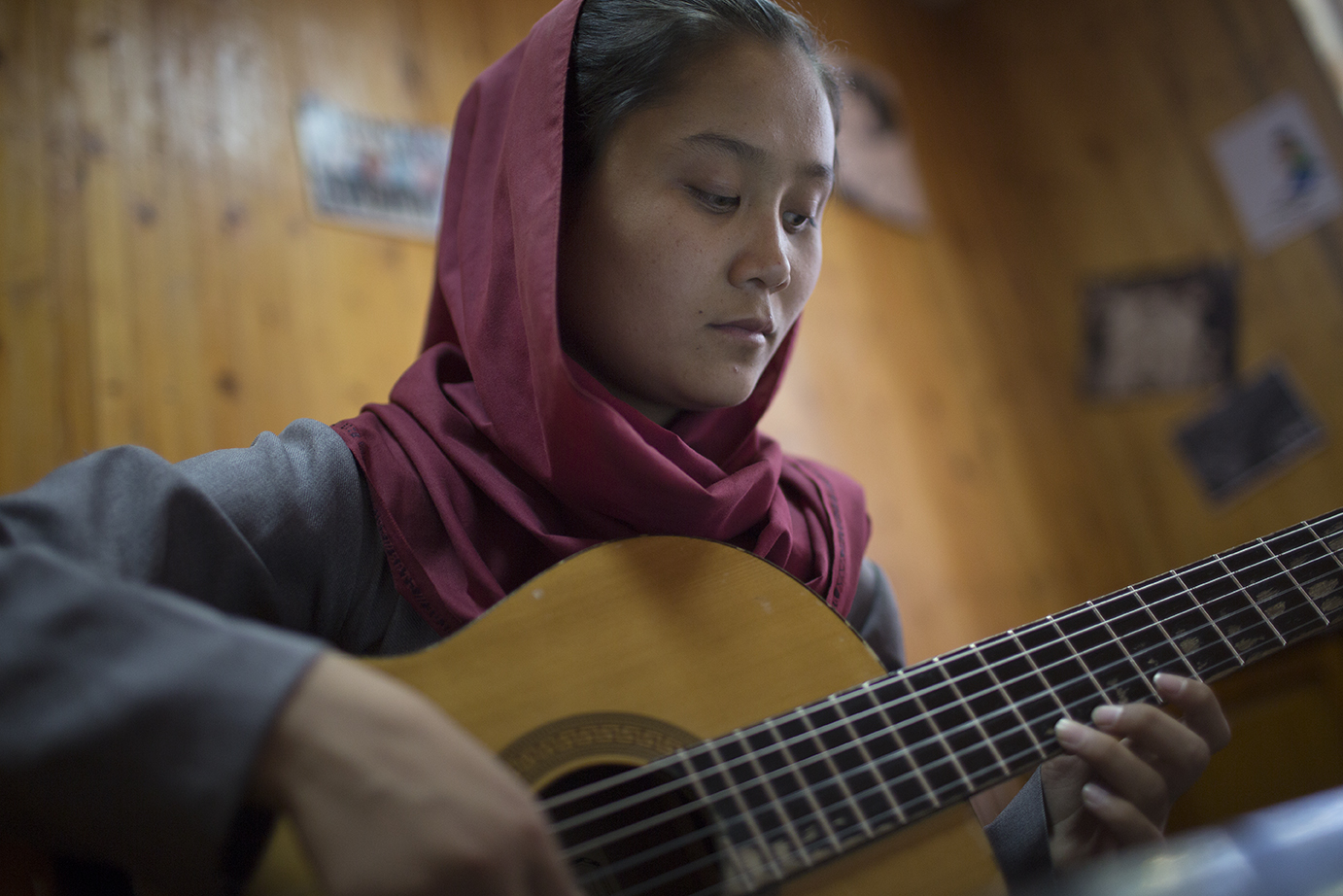 A young woman plays the lute-like  rabab , a uniquely Afghan musical instrument, during an instruction class at the Afghan National Institute of Music in Kabul.