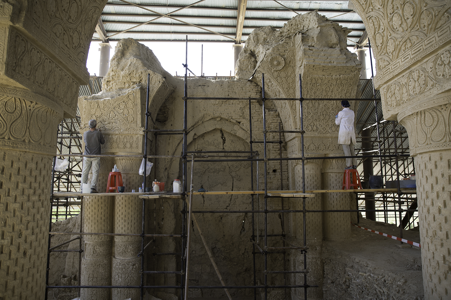 The crafted stucco adorning the eighth century CE pillars of Noh Gunbad in Balkh is stabilized by conservation experts to maintain their intricate and unique decorative forms. An international team of experts, led by the Aga Khan Trust for Culture, has conducted groundbreaking preservation work at this site since 2009.