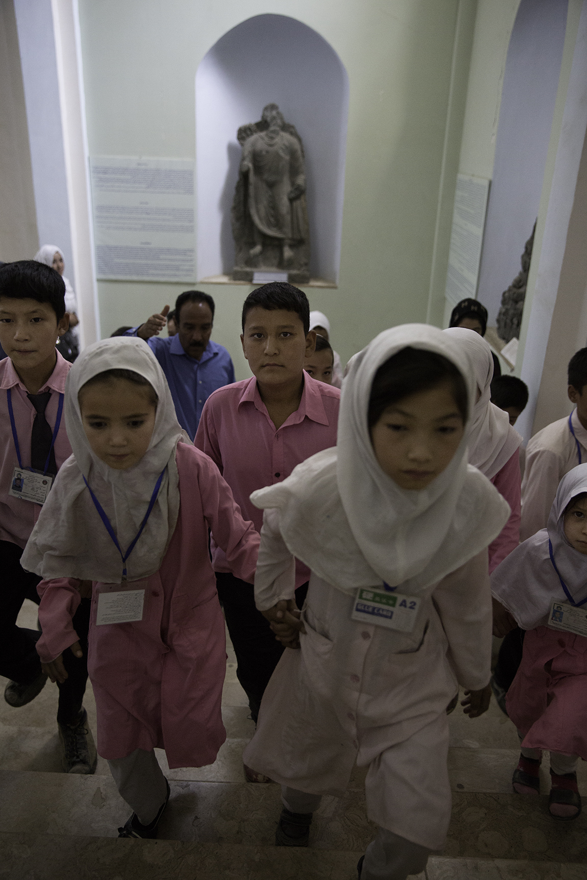 Schoolgirls and boys are guided past exhibits at the National Museum of Afghanistan in Kabul. The museum has become the centerpiece of attempts by Afghan educators to teach the post-war generation about their country's rich and diverse culture.