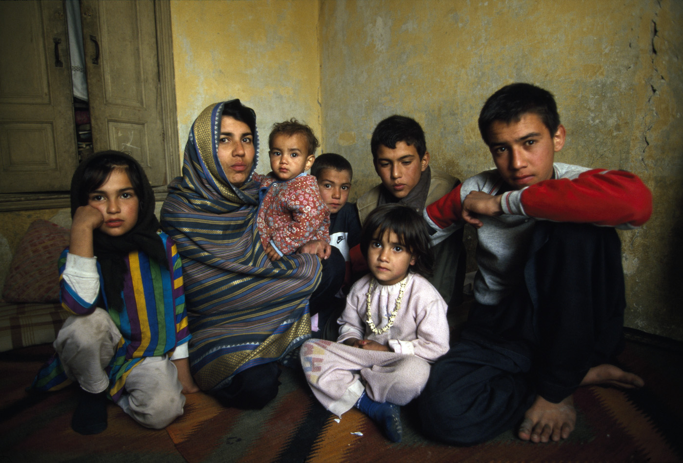 October 1996: A widow of an Afghan mujahideen fighter seeks refuge with her children in an unheated apartment in Kabul. The women's husband was killed while fighting the Taliban. Kabul has between 30,000 and 50,000 war widows with little means of support and their situation became more precarious once the Taliban took over in September 1996.