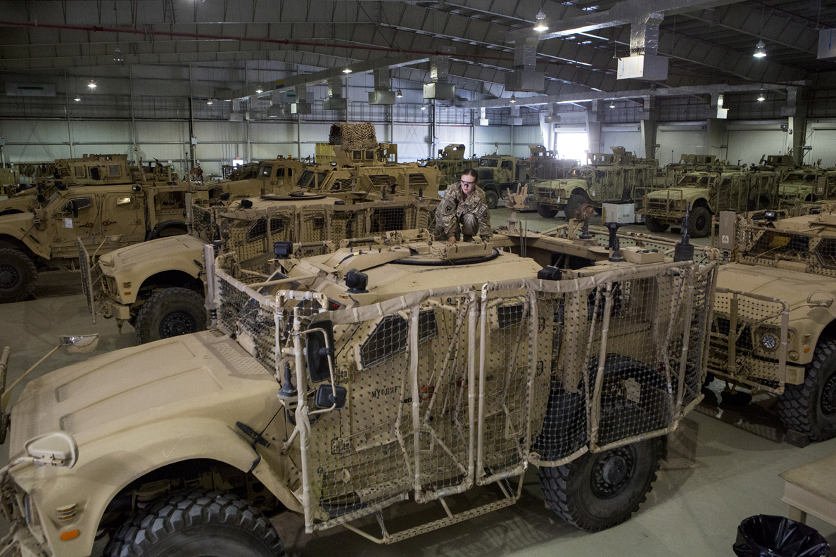 May 2013: A U.S. Army soldier at Bagram Air Base sits on top of a Mine-Resistant All-Terrain Vehicle, MRAP, looking for any loose ammunition before the vehicle is shipped back to the United States as part of the withdrawal of U.S. forces from Afghanistan.