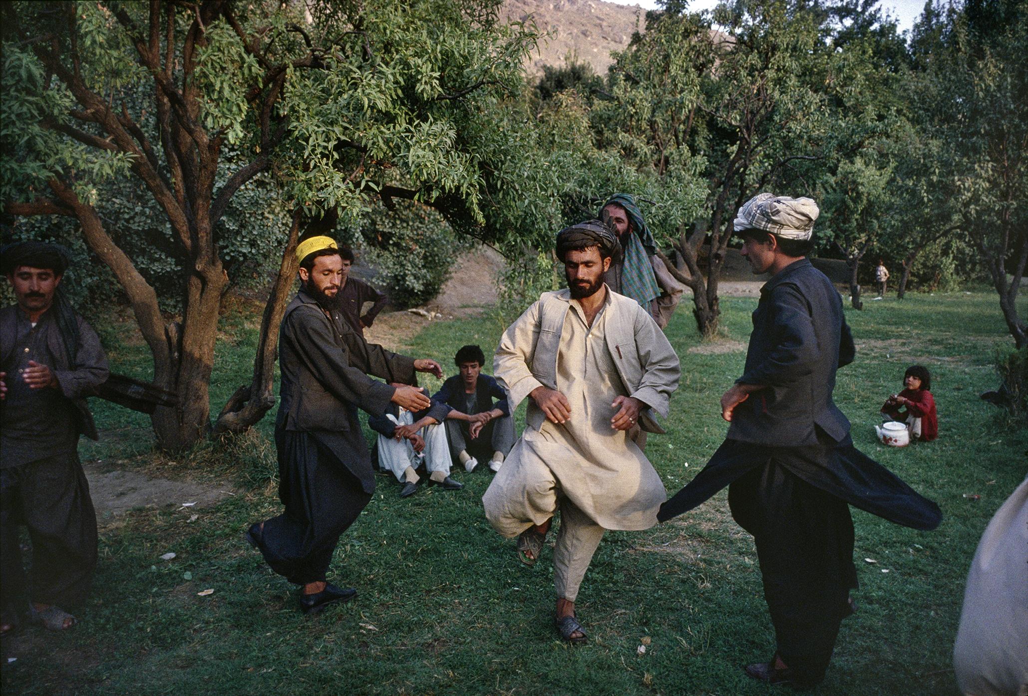 September 1991: Afghans in the Bagh-e Babur, or Babur's Garden, perform the attan, a traditional Afghan folk dance.