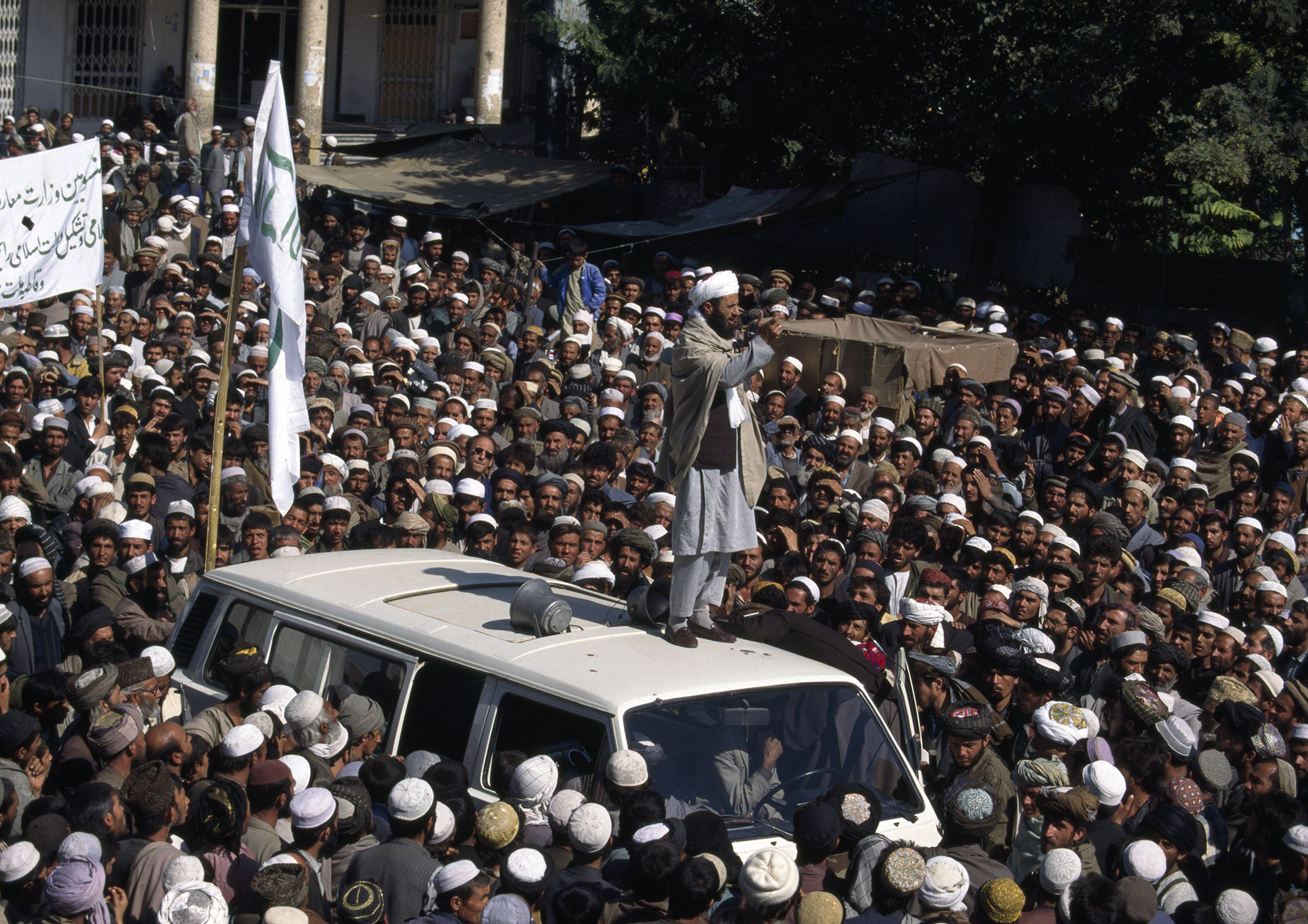 October 1996: A Taliban mullah speaks to a crowd gathered in central Kabul after Taliban forces took control from the Rabbani government.