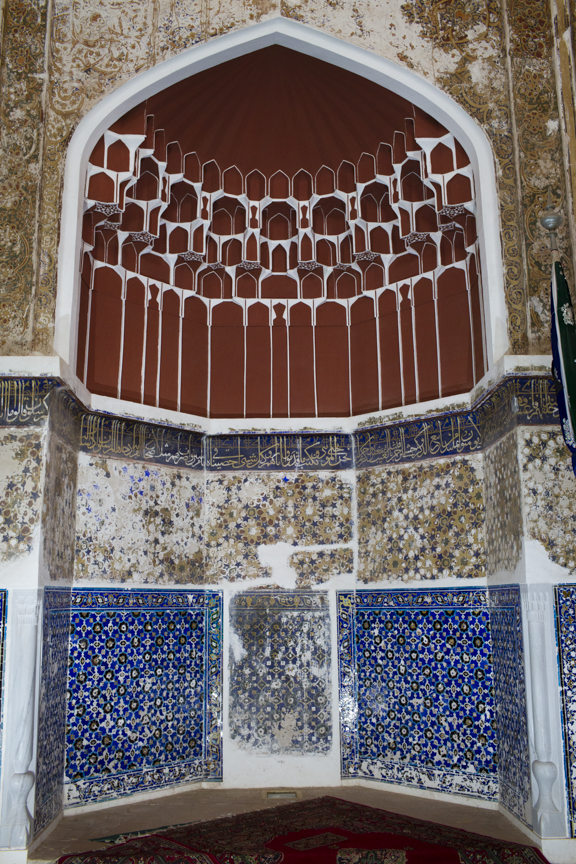 An ornamental vault, known as a  muqarnas , inside Shahzada Abdullah's mausoleum. These intricate, plaster  muqarnas  are traditional features in Islamic architecture from Iran all the way to Morocco. During restoration, the  muqarnas  were repaired and repainted using natural ochre pigments, true to the original techniques.