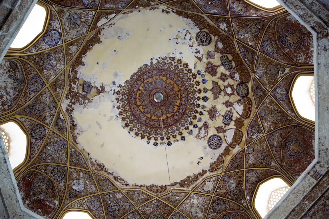 An upward view of the exquisitely painted central dome of the interior of Shahzada Abdullah, spanning 12.5 m, the dome underwent structural stabilization to its original brickwork, and plaster and paint were judiciously re-applied to the most fragile areas.