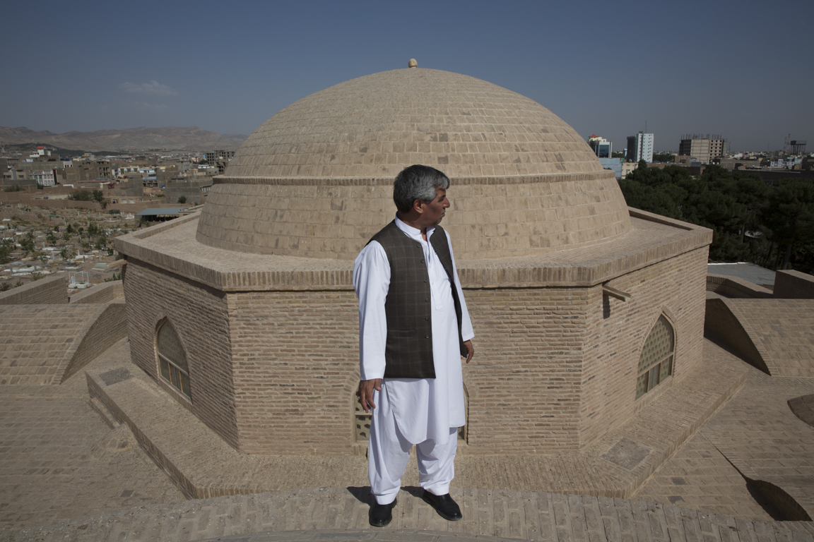 Project Engineer Habib Noori gazes out from the rooftop of Shahzada Abdullah's west  iwan , whose dome underwent extensive repairs and stabilization during restoration.