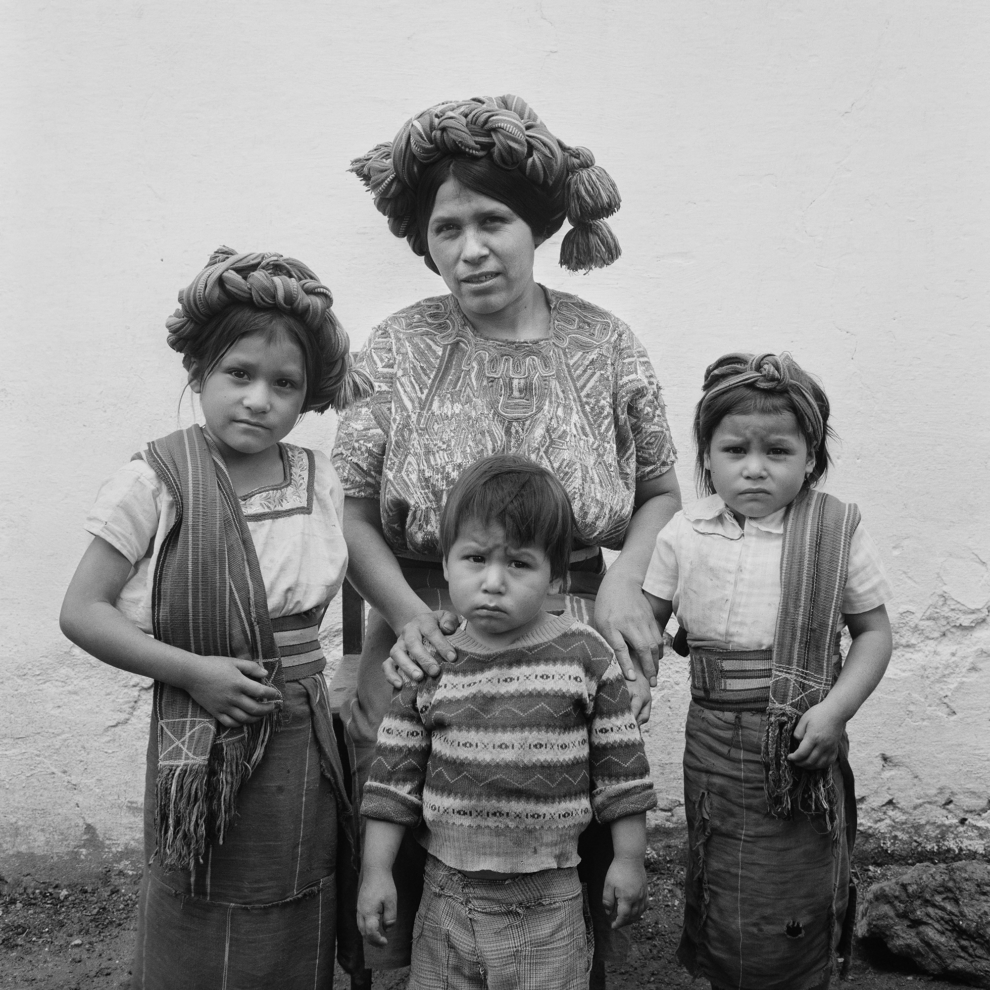 An Ixil Maya mother, Ana Raymundo Brito, 34 years, and 3 of her 12 children pose for a picture in Nebaj, Guatemala, January 1, 1984.
