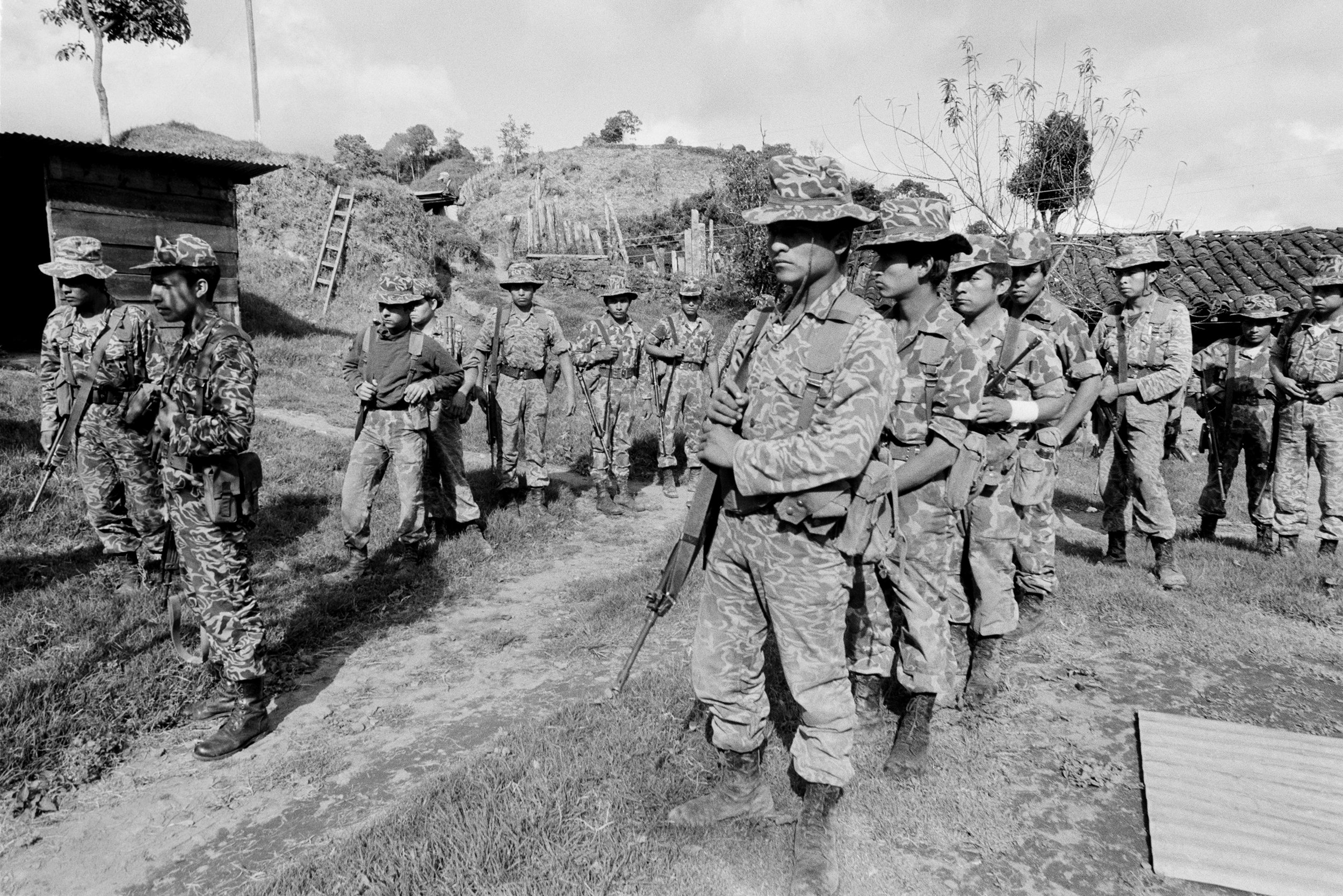 Guatemalan army soldiers form patrols to search for armed militants from the Guerrilla Army of the Poor, EGP, following an attack 24-hours earlier on January 19, 1982 in San Juan Cotzal, Guatemala.