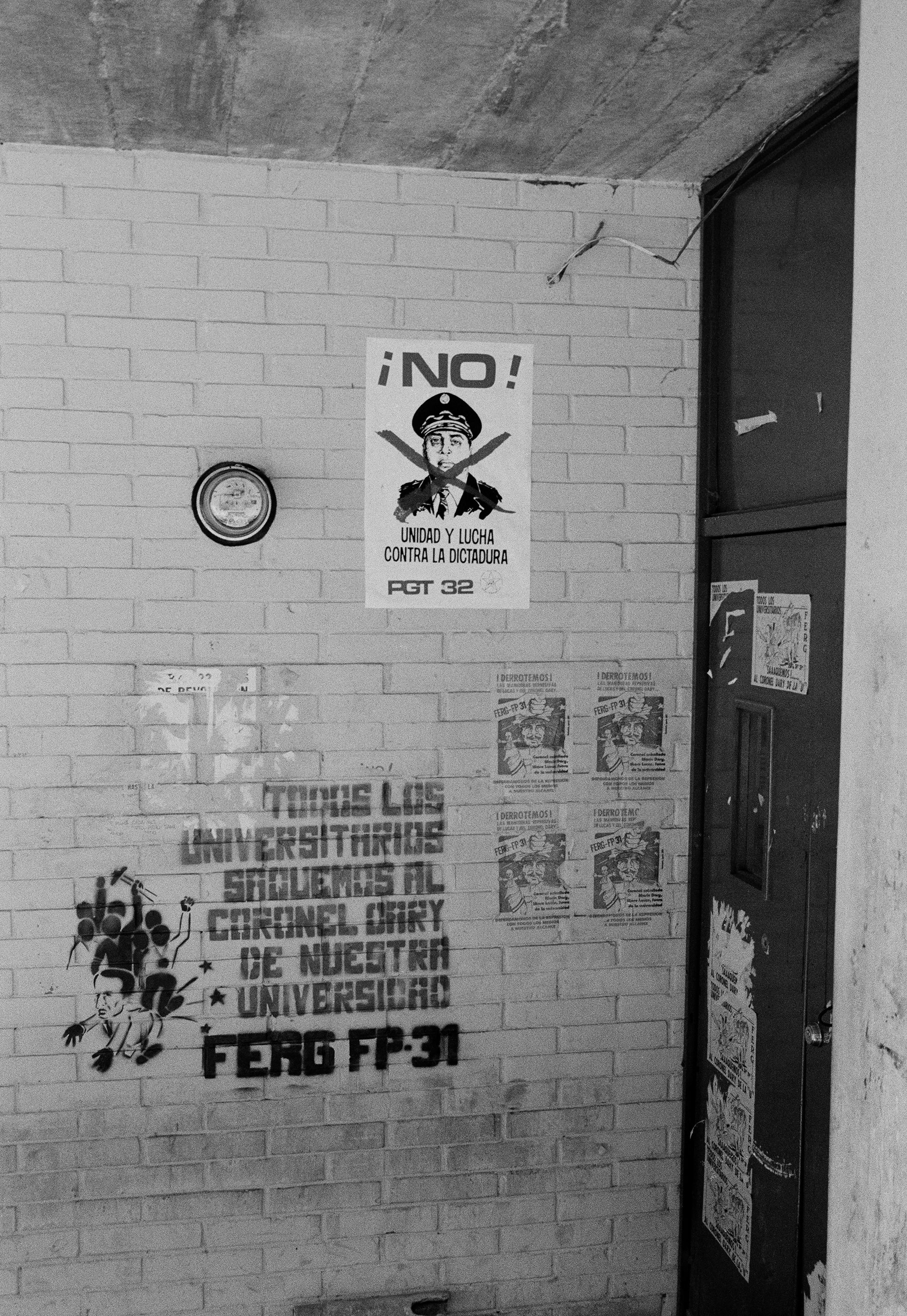 Graffiti in support of leftist insurgent groups and anti-government posters collect on a wall in the University of San Carlos campus in Guatemala City, Guatemala, March 1, 1982. The university served as an active space of resistance throughout the domestic armed conflict, challenging the militarization and violence of the state and its U.S.-sponsored imperialistic policies.