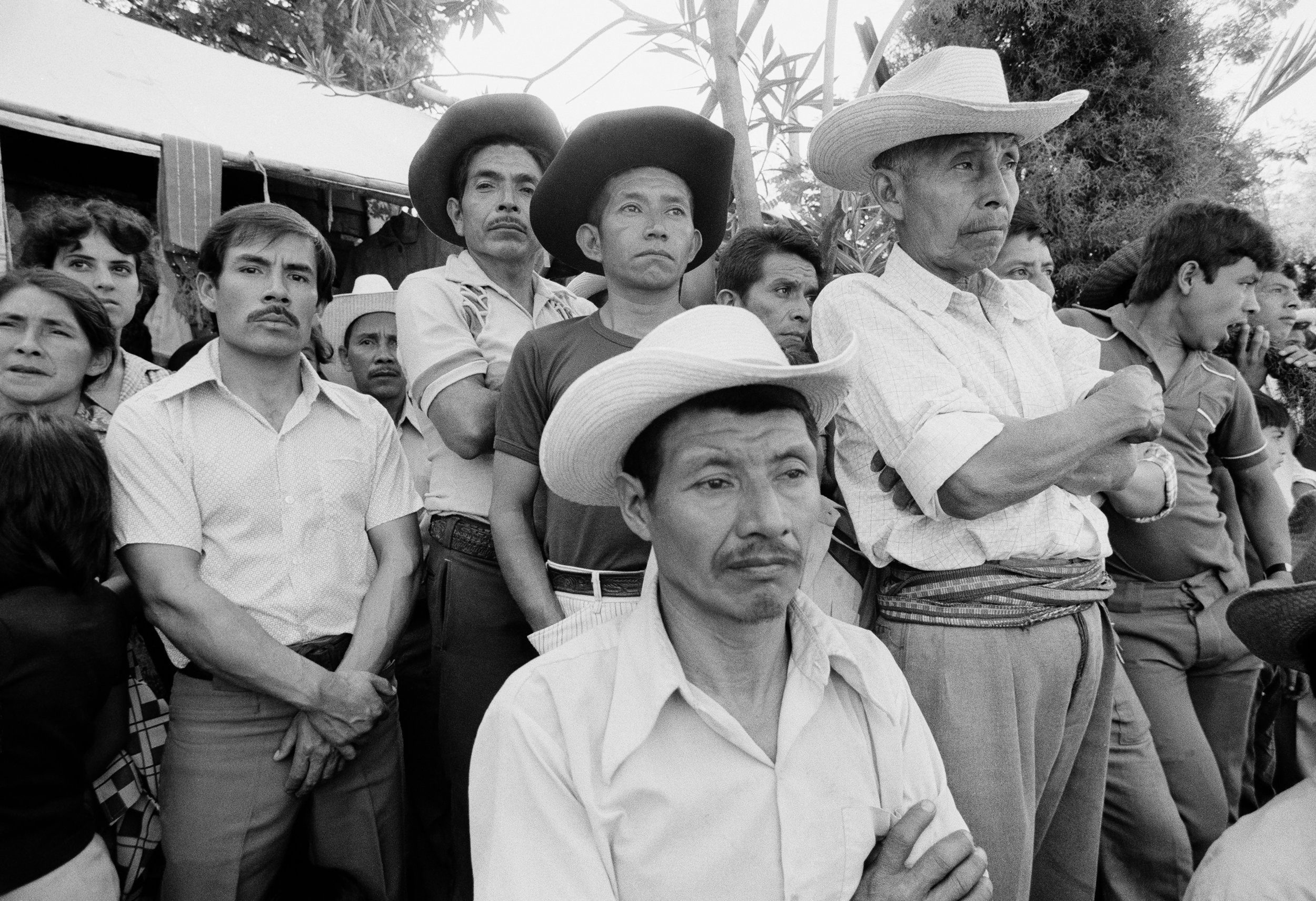 A crowd in Sololá, Guatemala listen to speeches from the expected candidate General Ángel Aníbal Guevara during the presidential election campaign, February 26, 1982. Handpicked to succeed outgoing president Fernándo Romeo Lucas García, Guevara was declared the winner of the election on March 7, 1982, which was then widely denounced as fraudulent. A military coup d'état on March 23, 1982 led by General Efraín Ríos Montt prevented him from assuming power.