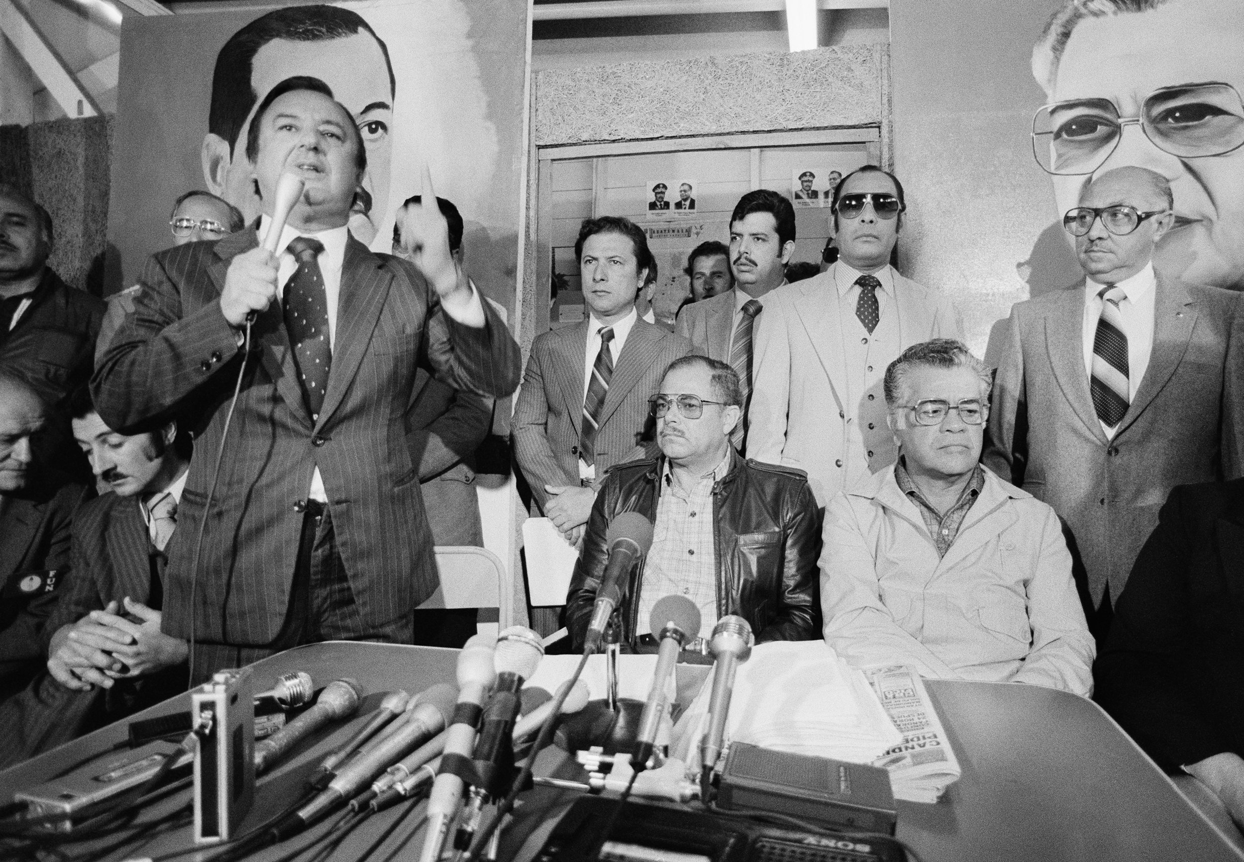 The winner of the 1982 presidential elections, General Ángel Aníbal Guevara, center, seated, looks on with political party leaders at a press conference March 25, 1982 following a military coup d'etat March 23, 1982 in Guatemala City, Guatemala. General Guevara was the designated successor to the previous military president General Romeo Lucas Garcia in the March 7 elections followed by a military coup d'état by General Efraín Ríos Montt.