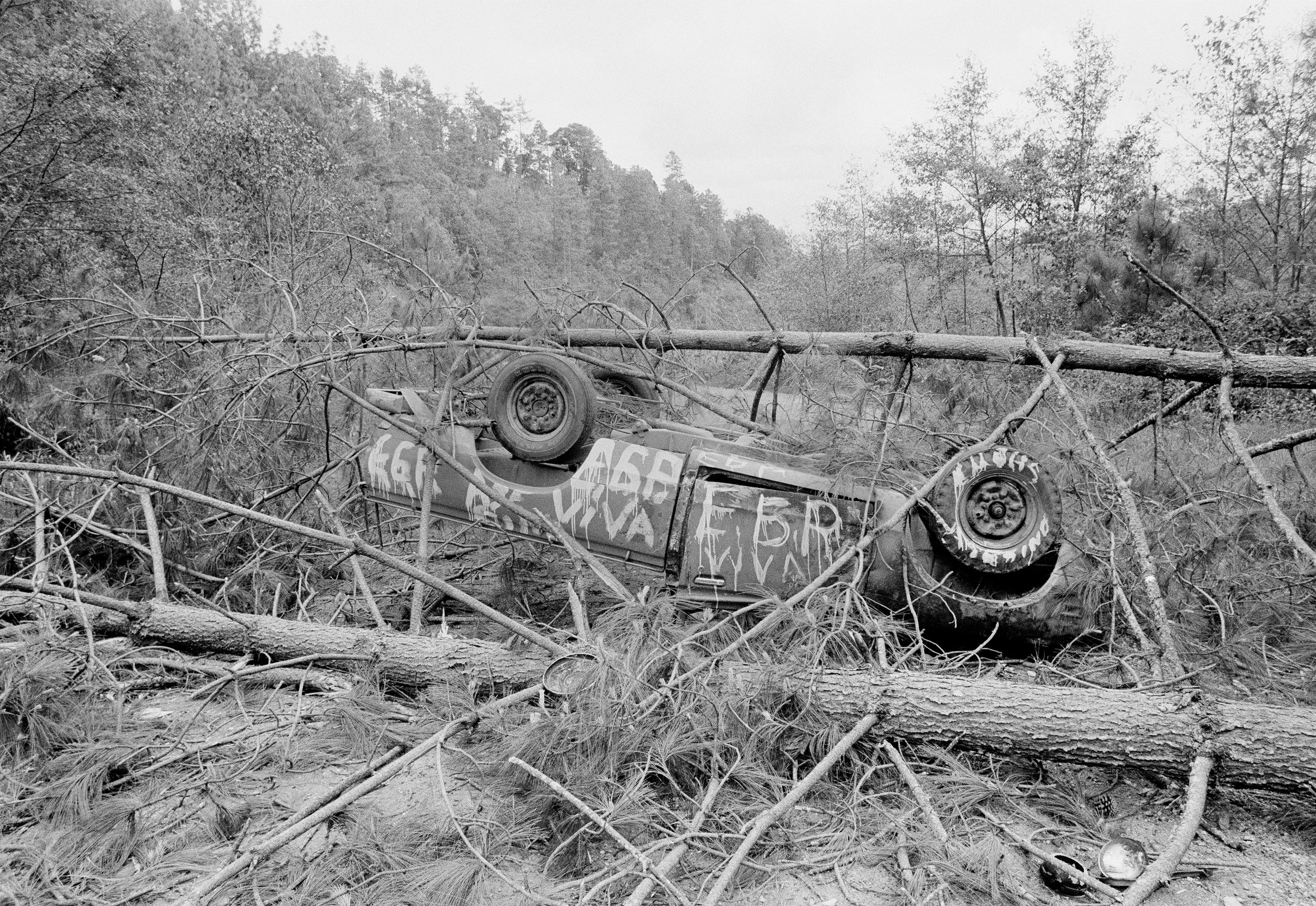 A section of the Pan American Highway was blocked by a destroyed car and felled trees cut by the Guerrilla Army of the Poor, EGP, blocking the road on the day of presidential elections on March 7, 1982.