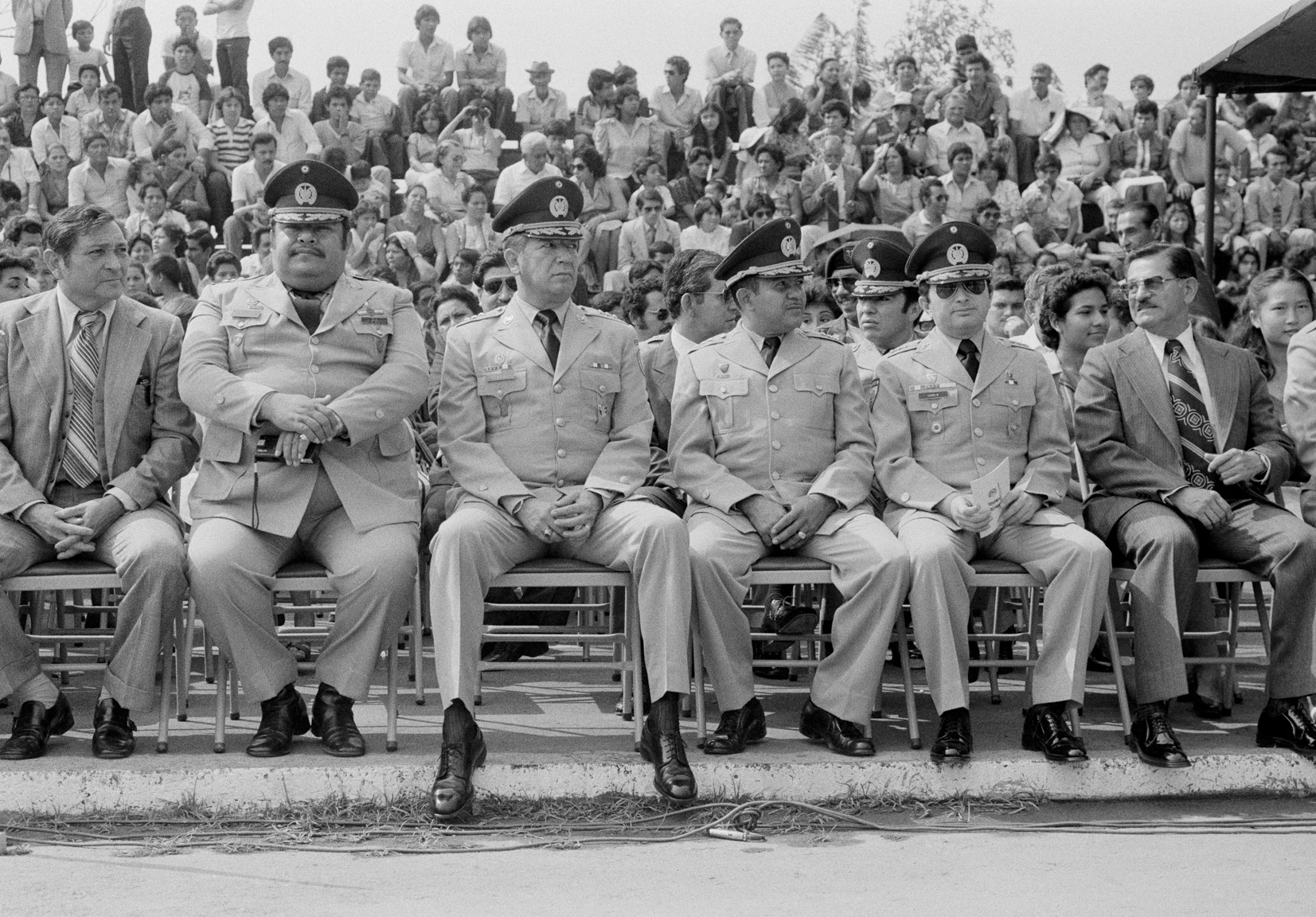 Salvadoran military commanders and former Vice-Minister of Defense, Treasury Police Colonel Nicolas Carranza, 3rd left, sit during a ceremony May 1983, San Salvador, El Salvador.
