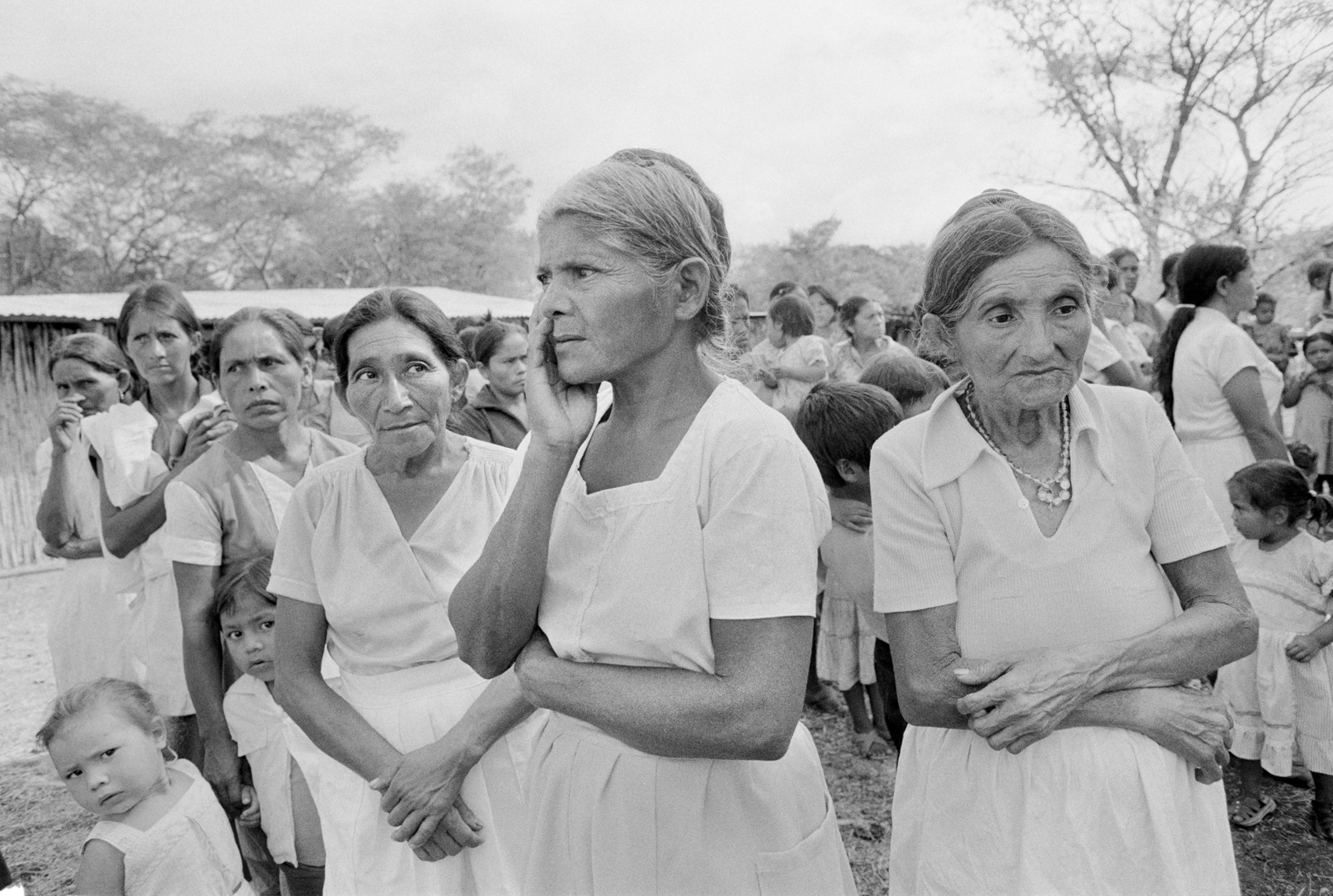 "Salvadoran women wait in line to see Salvadoran and American medical personnel during a ""Soldier of Fortune"" magazine's free medical clinic held in San Francisco Gotera, El Salvador February 21, 1984. Magazine owner and publisher Robert Brown and his magazine donated weapons training and $750,000 of medical and surgical equipment to Salvadoran army doctors."