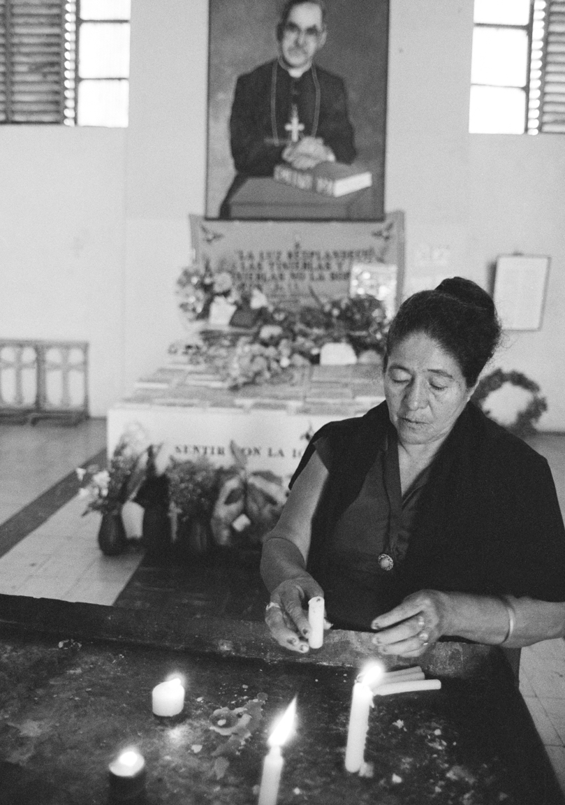 A woman lights a votive candle during the 4th anniversary of the death of Archbishop Oscar Romero March 24, 1984 in San Salvador, El Salvador. A right-wing group assassinated Romero March 24, 1980 while he celebrated a mass in San Salvador.