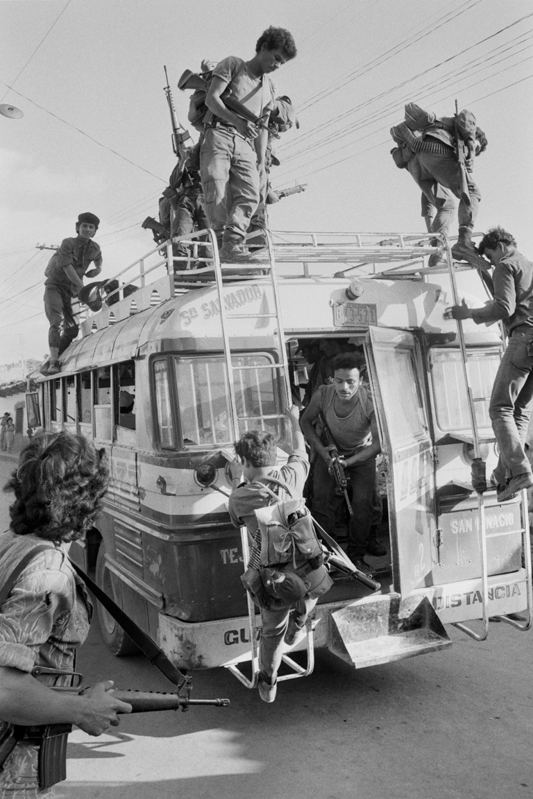 Armed rebels from the Fuerzas Populares de Liberación, FPL, disembark from a passenger bus February 6, 1983 in La Palma, El Salvador. FPL, a leftist militant group belonging to the Farabundo Martí National Liberation Front, FMLN, or Frente Farabundo Martí para la Liberación Nacional, was one of the primary insurgent groups fighting the right-wing Salvadoran government supported by the United States.