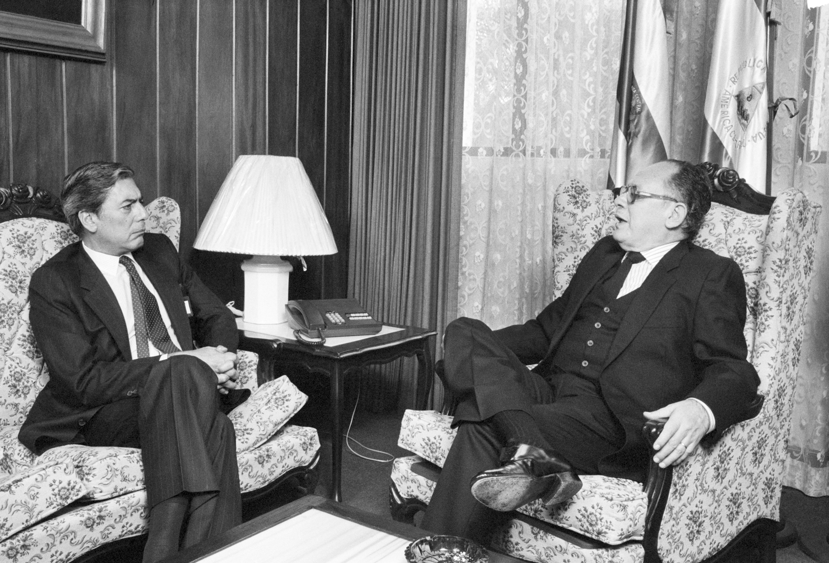 Peruvian author Mario Vargas Llosa, left, interviews Salvadoran President Dr. Alvaro Magaña, right, May 10, 1984 at the Presidential Palace in San Salvador, El Salvador. Vargas Llosa was writing about the 1984 Salvadoran presidential elections for Time magazine.