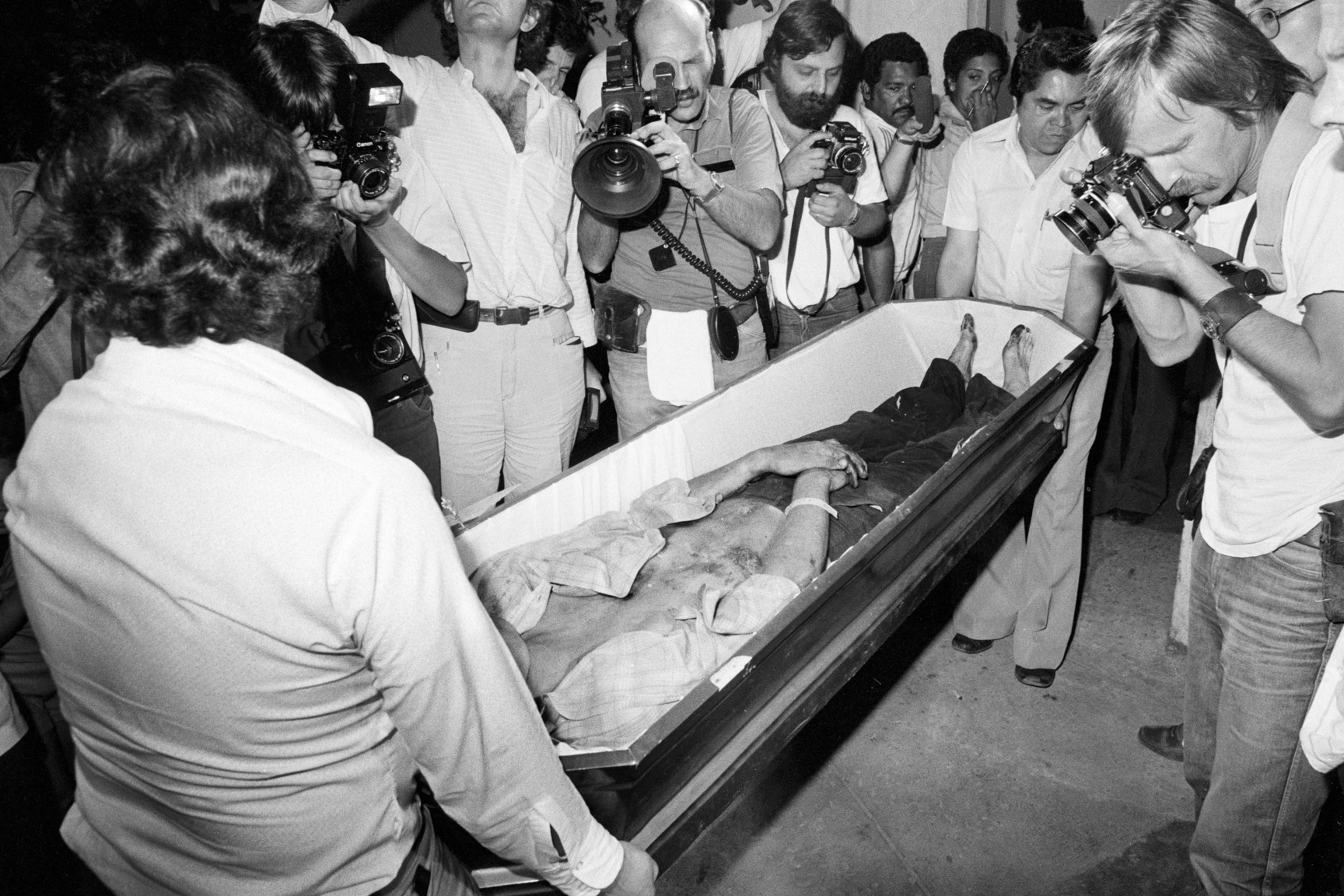 Members of the media film the dead body of a Dutch journalist killed in Chalatenango department March 19, 1982 in a funeral parlor in San Salvador, El Salvador. Four Dutch journalists were shot and killed by Salvadoran security forces while they were pursuing an interview with leftist guerrillas from the Farabundo Martí National Liberation Front, or FMLN. Jacobus (Koos) Koster, Hans Ter Laan, Jan Quiper and Johannes (Joop) Willemsen were shot at close range and suspicions lie with the Salvadoran security forces which followed the journalists from San Salvador to Santa Rita, Chalatenango and killed them in a rural area.