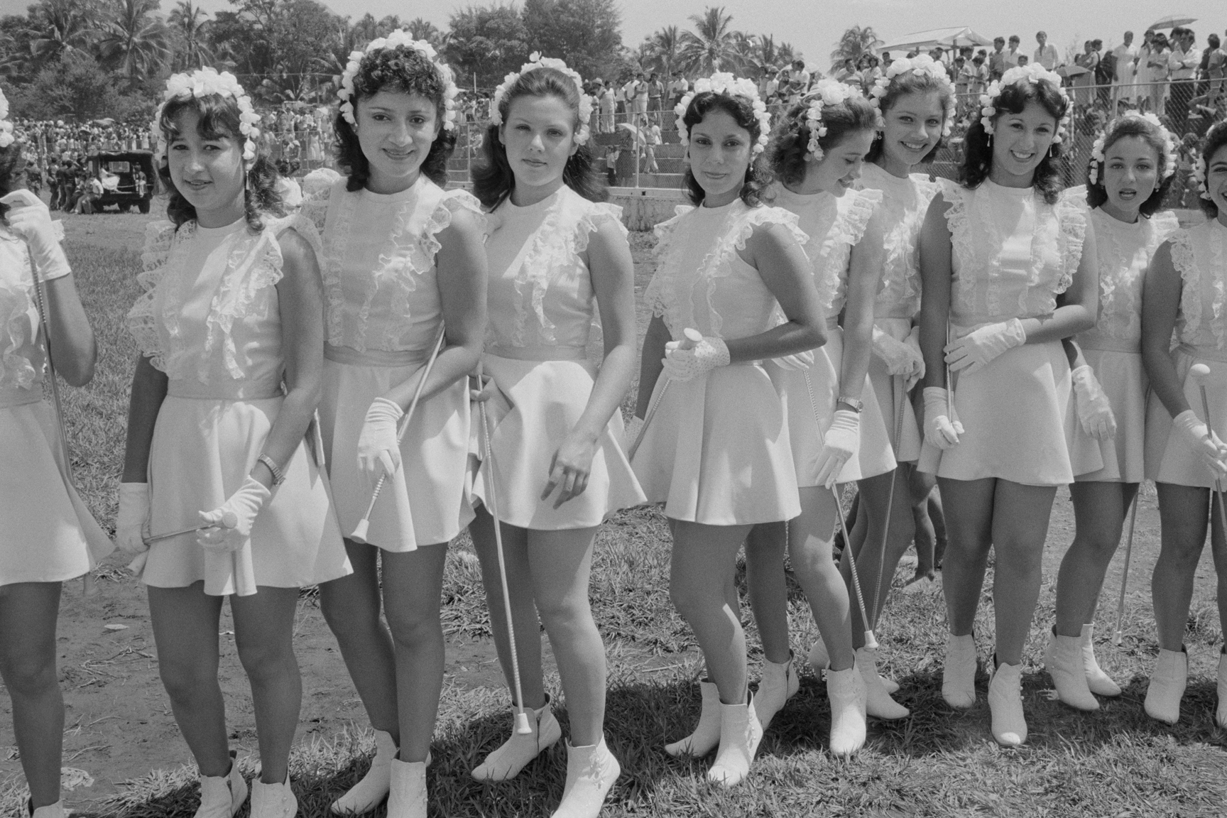 Marching band majorettes line up before a military parade for graduating army cadets October 1982 in Santa Tecla, El Salvador.