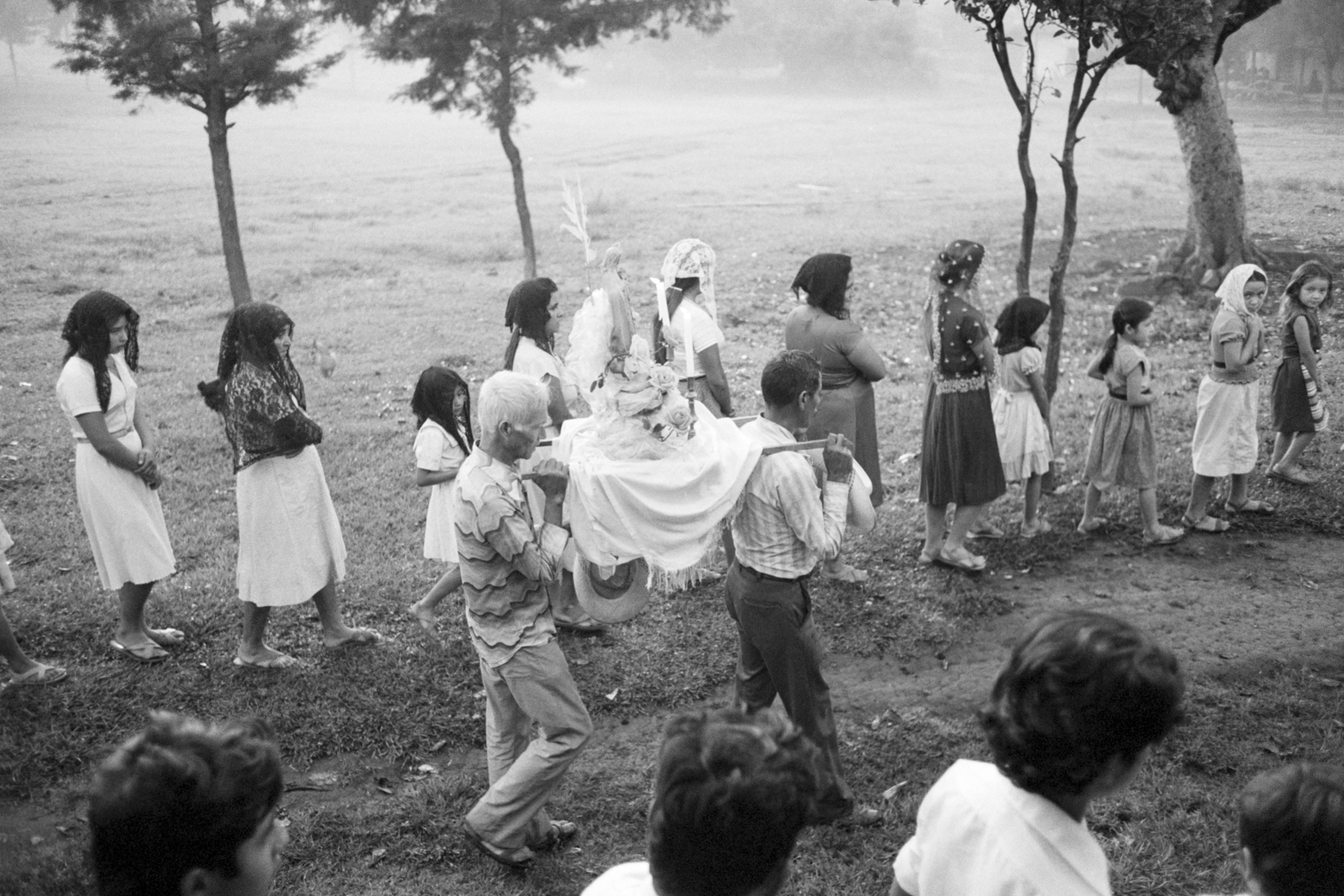 An altar with a statue of Jesus Christ is carried in a religious procession through the streets October 23, 1983 in Perquin, Morazán department, El Salvador.