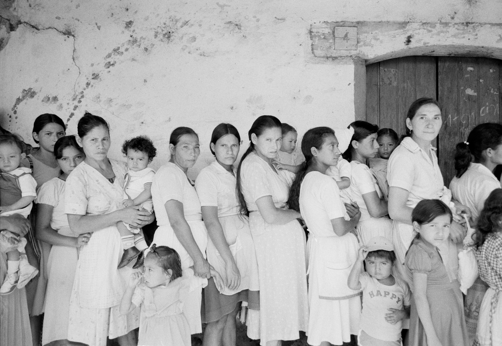 Women line up for medical care at a military clinic October 23, 1983 in Perquin, Morazán department, El Salvador. The Salvadoran government abandoned Perquin and several towns in Morazán department when the territory fell under the control of the FMLN.