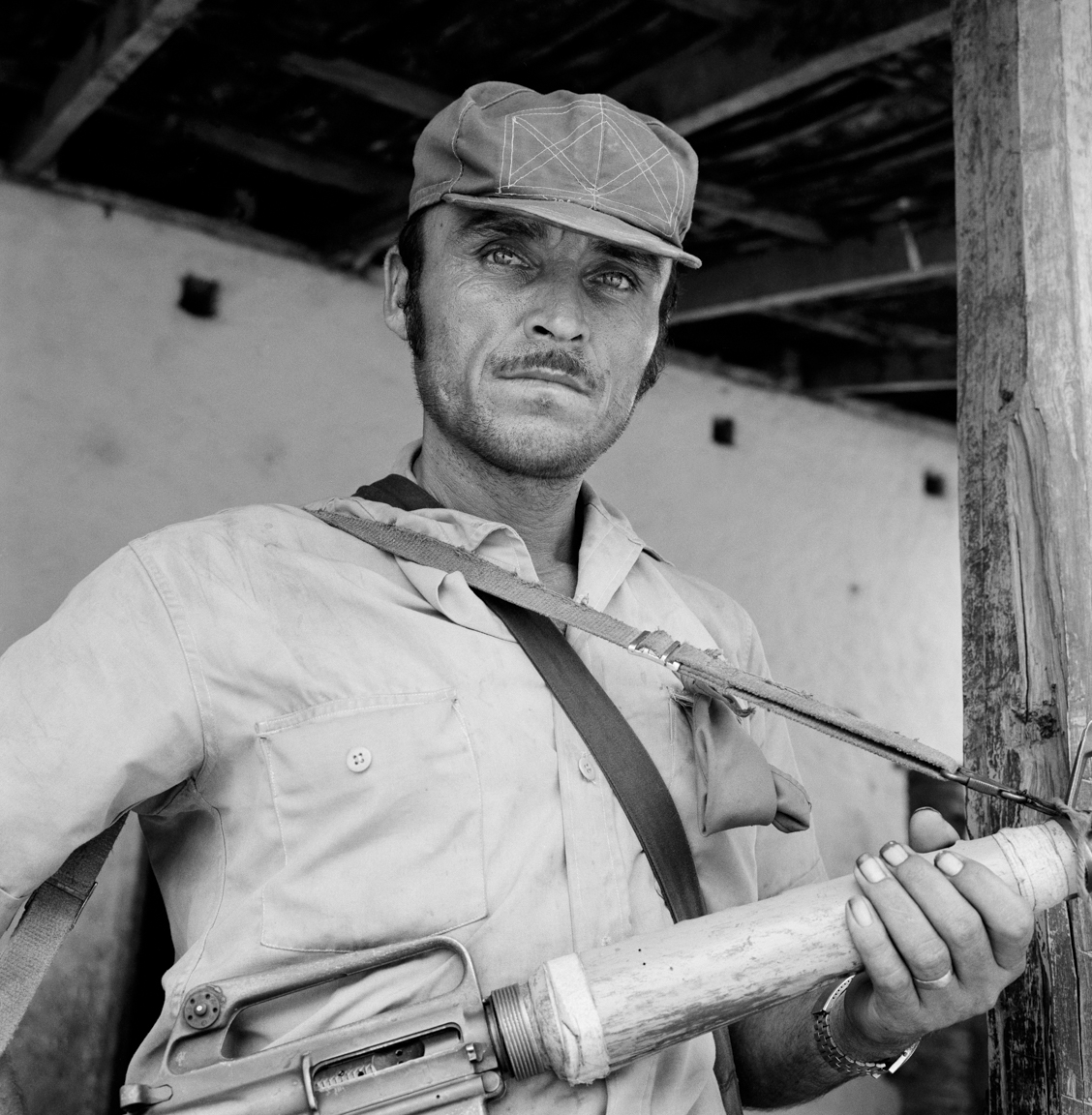 A portrait of a People's Liberation Forces (FPL) guerrilla fighter as he stands in front of a building May 10, 1983 occupied during an attack in Cinquera, El Salvador. At the time, El Salvador was engaged in what became a 13-year civil war between successive right-wing governments (backed by the US and others) and various armed guerrilla factions that eventually claimed over 75,000 lives before ending in 1992.