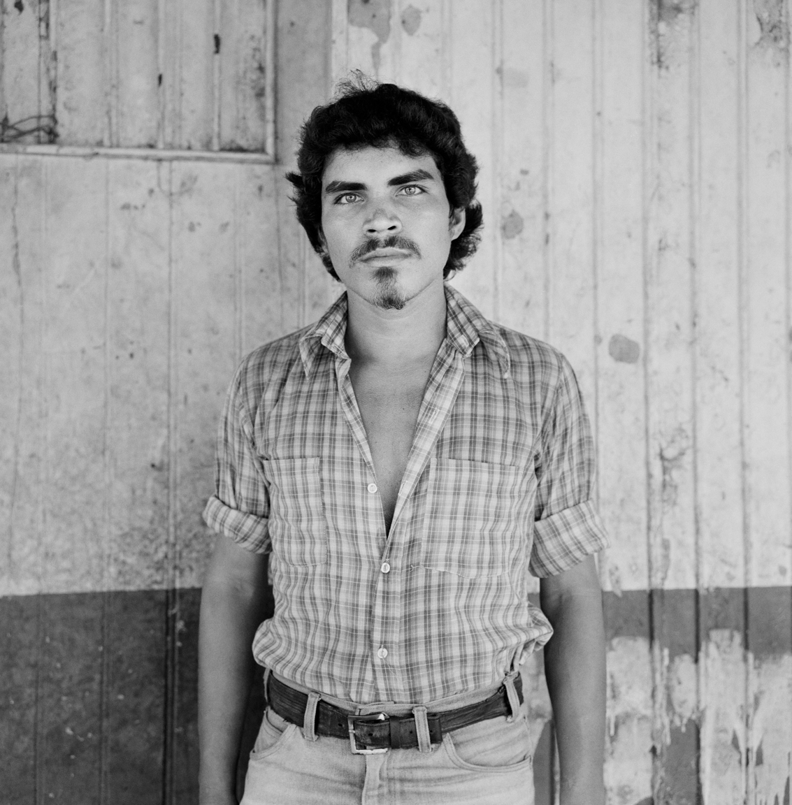 A portrait of a People's Liberation Forces (FPL) guerrilla fighter as he stands in front of a building May 10, 1983 occupied during an attack in Cinquera, El Salvador.