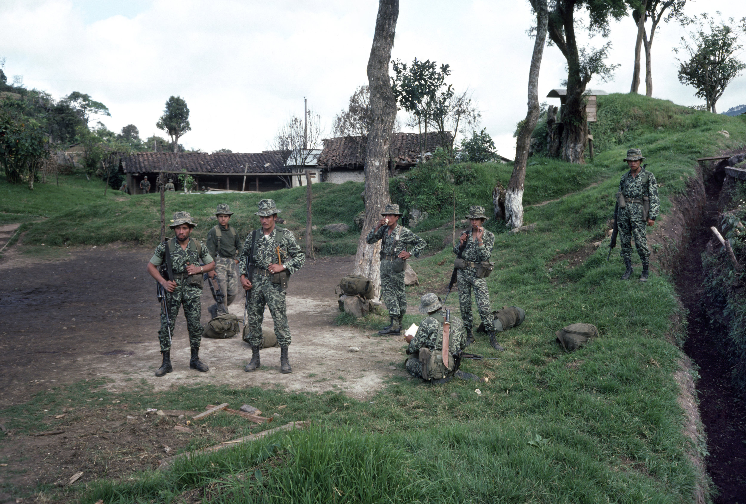 Guatemalan army soldiers rest before moving out in search of insurgents that attacked the army base one day earlier in San Juan Cotzal, Guatemala, January 20, 1982. On January 19, 1982, the Guerrilla Army of the Poor, EGP, attacked the army garrison in San Juan Cotzal with a reported 300 insurgents killing 37 government soldiers.