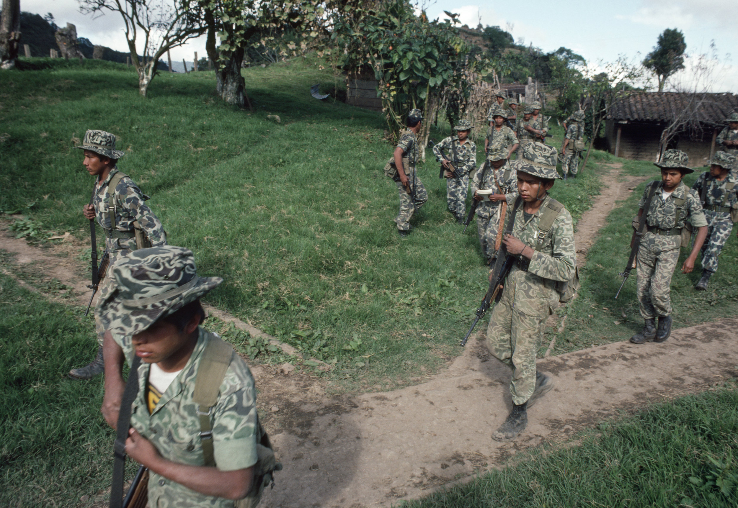 Guatemalan army soldiers armed with Israeli-supplied Galil assault rifles move out in search of leftist insurgents that attacked the army base one day earlier on January 19, 1982 in San Juan Cotzal, Guatemala, January 20, 1982.