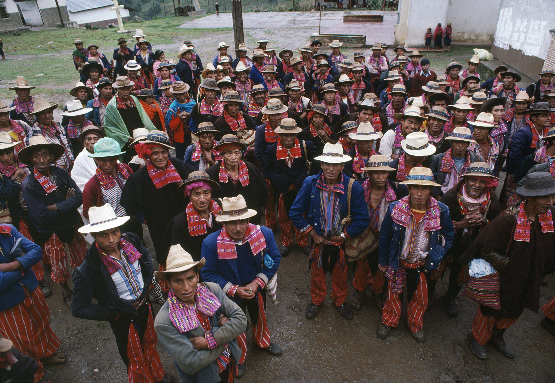 Members of a local Civil Defense Patrol stand for a photograph in the town square in Todos Santos, Guatemala on September 1, 1982.