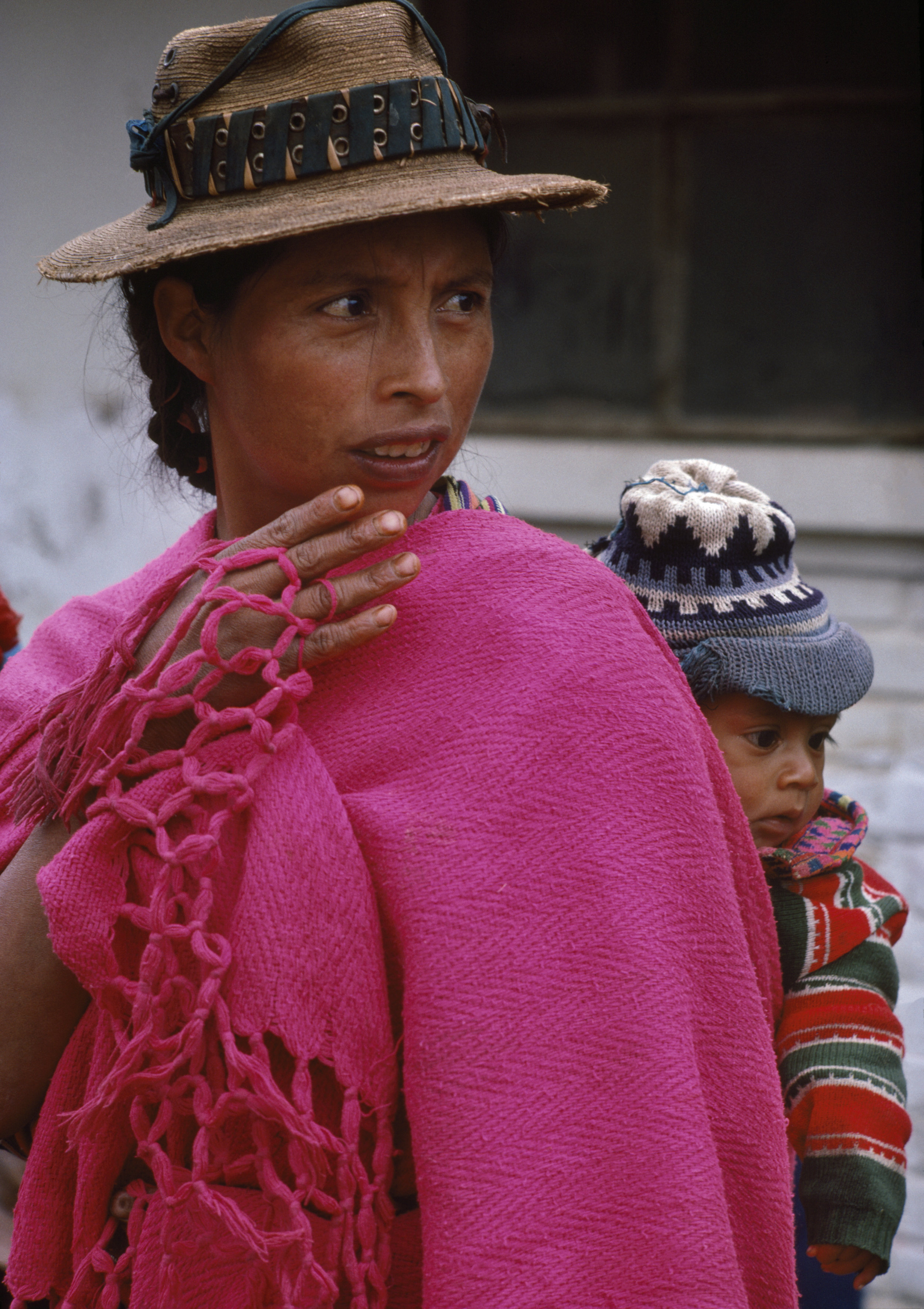 A woman observes a Civil Defense Patrol checkpoint in rural Huehuetenango, Guatemala, September 1, 1982.