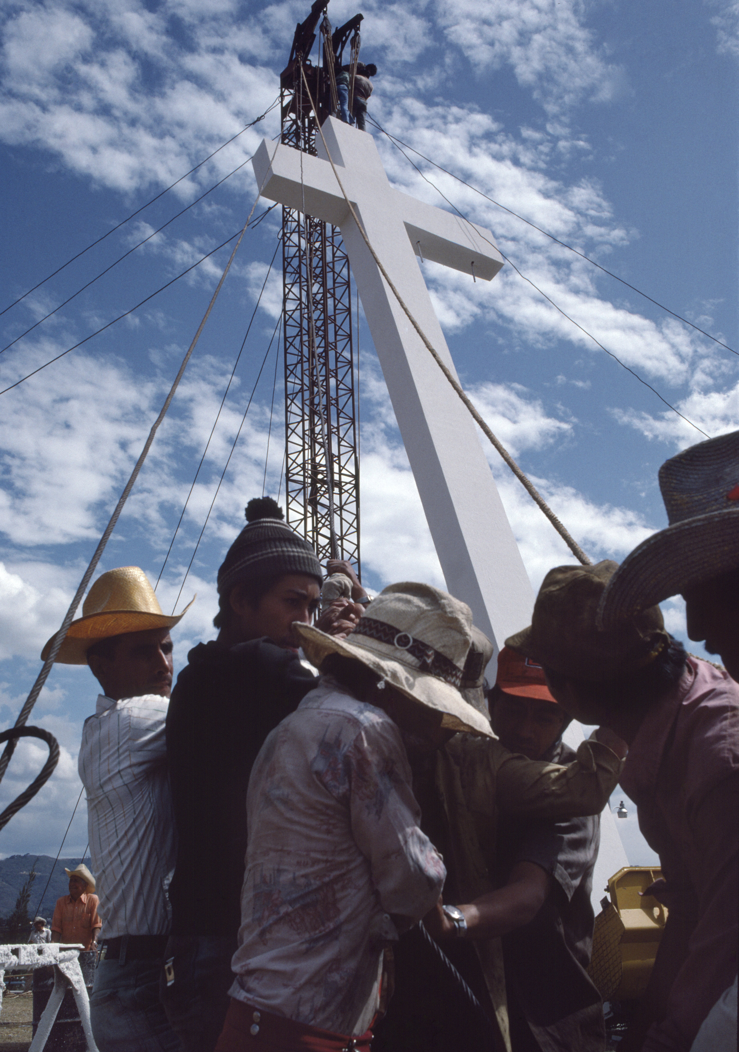 A cross is raised by a Guatemalan work crew during preparations for an open air mass by Pope John Paul ll in Guatemala City, Guatemala, February 26, 1983. Religion played a fundamental role in the civil war for both the guerrilla insurgency, who sympathized with the socially progressive Catholic movement of liberation theology, and the Guatemalan state, who used Fundamental Protestantism, and specifically the evangelical movement, as a means to stifle opposition to the military dictatorship and subvert the expansion of liberties and individual responsibility promoted through liberation theology.
