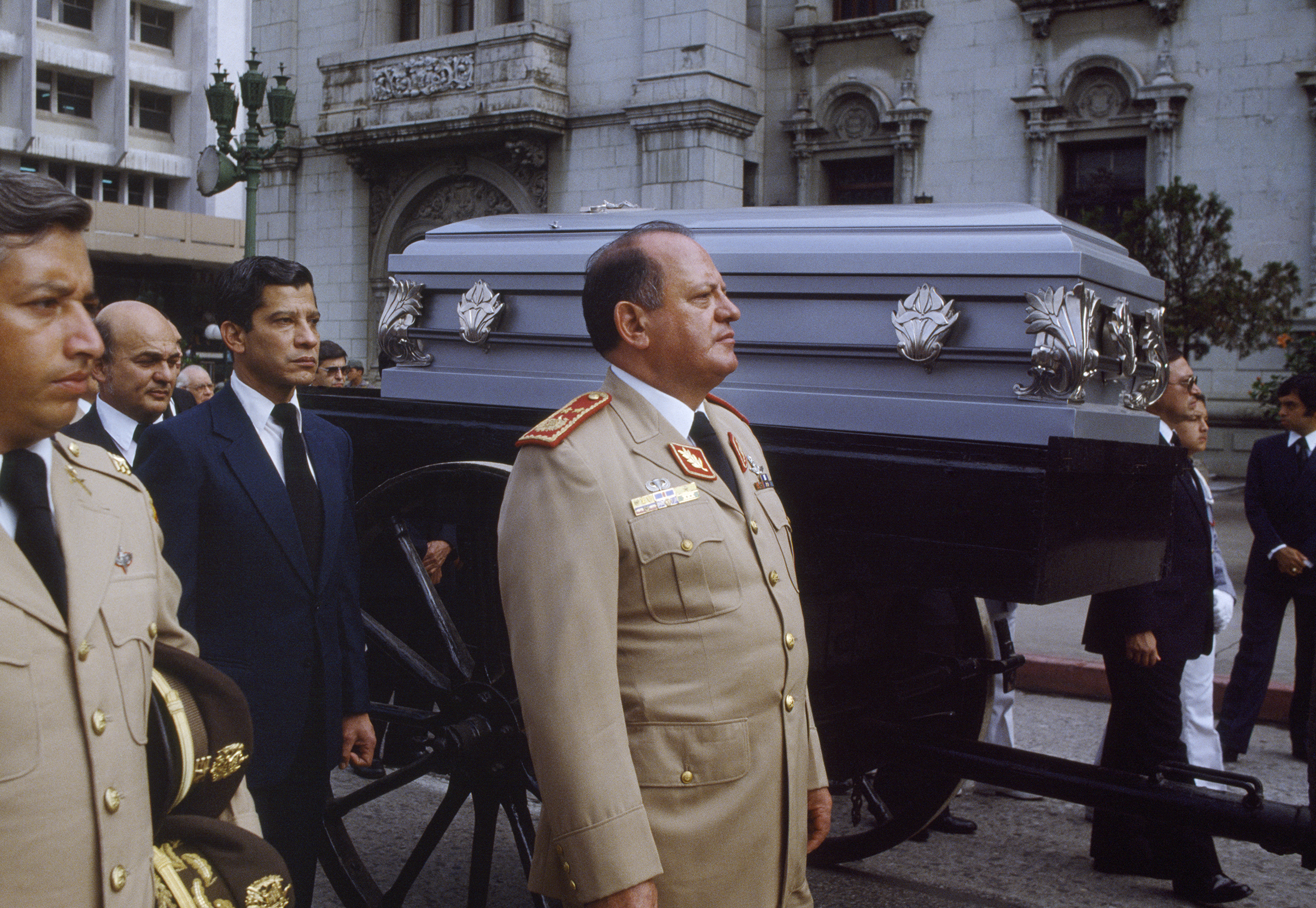 Guatemalan Defense Minister Brigadier General Óscar Mejía Víctores, 1930-2016, center, walks along the casket of Cardinal Casariego, Archbishop of Guatemala who died June 15, 1983 from a heart attack following the March 1983 visit of Pope John Paul ll to Guatemala. General Mejía Víctores deposed President and General Ríos Montt in a coup d'état on August 8, 1983. Mejía has since been indicted in both Spain and Guatemala on charges of genocide, as well as torture and crimes against humanity, for his rule as president in the internal armed conflict.