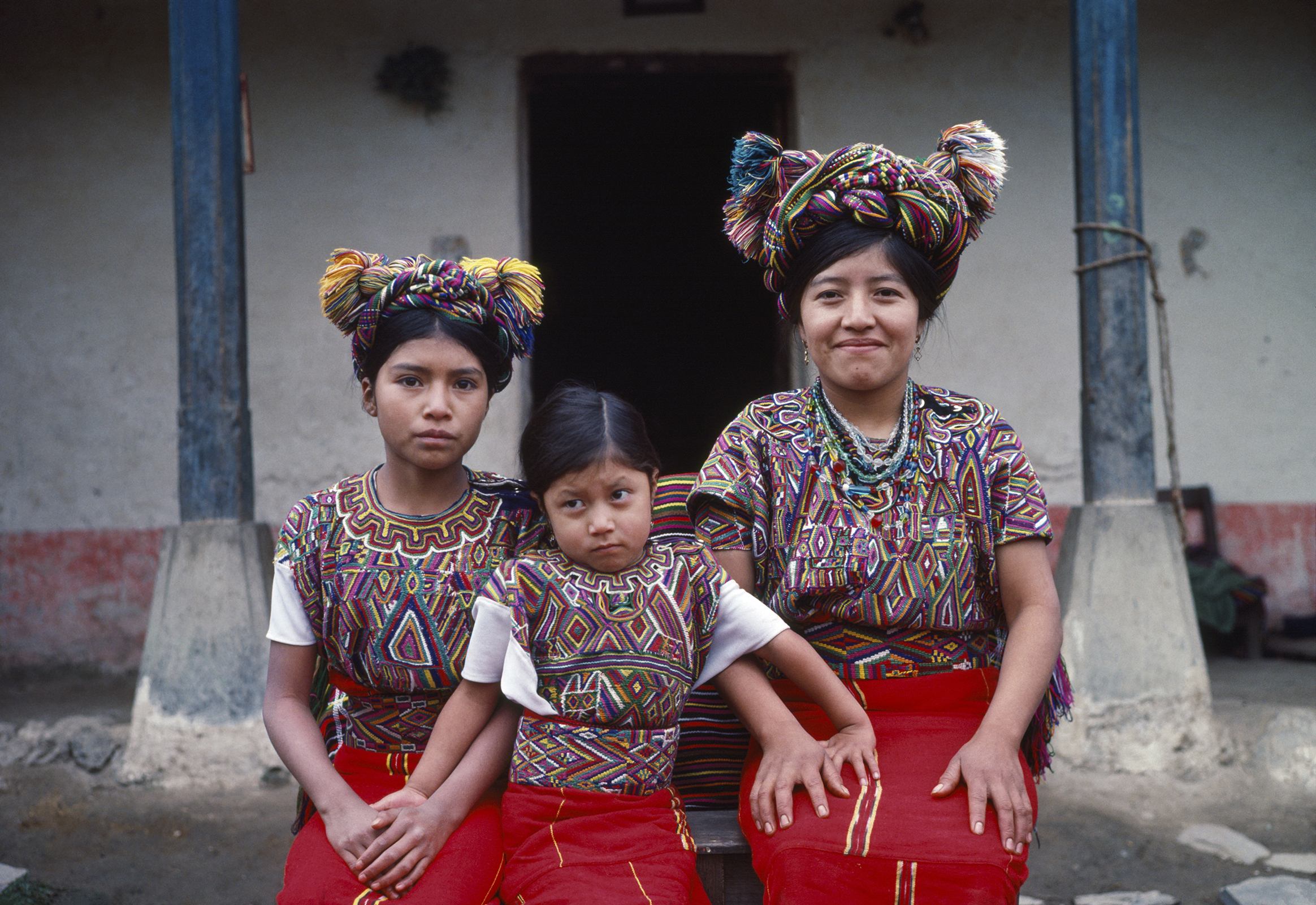 Josefa Cedillo Marcos, left, 13 years, Juana Cedillo Perez, center, 6 years, and cousin of Josefa, and Señora Cedillo Marcos, right and mother of Josefa, sit for a photograph in the Pensíon Ardavin in Nebaj, Guatemala on January 1, 1984. Josefa Cedillo Marcos grew up to be a school teacher and witnessed frequent armed violence of the civil war in the Ixil Maya region.