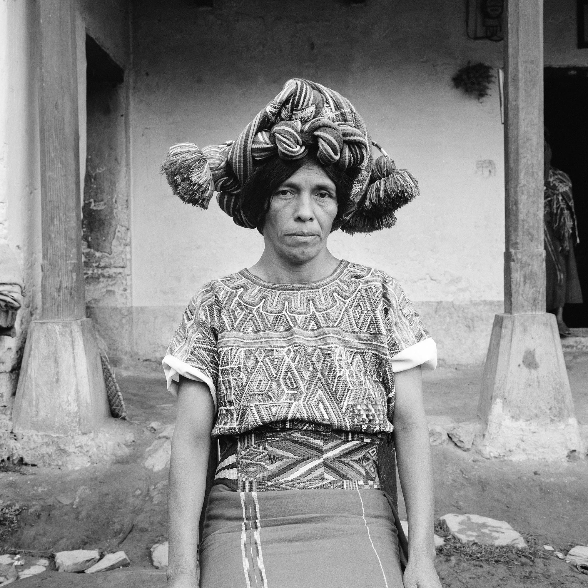 Petrona Brito, an Ixil Maya woman wearing a traditional head dress, sits for a picture in Nebaj, Guatemala, January 1, 1984.