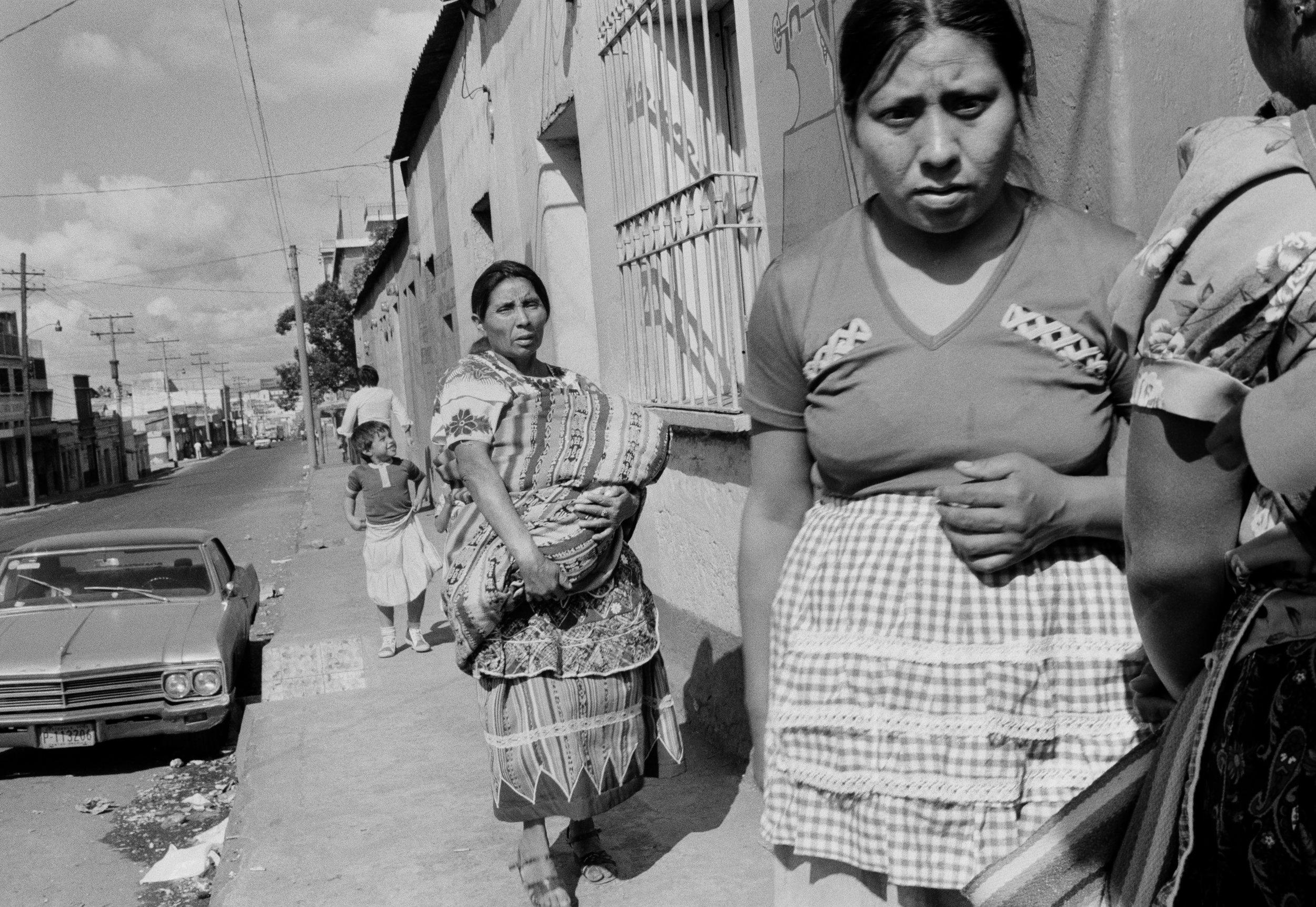 Women walk along a downtown street October 15, 1982 in Guatemala City, Guatemala.