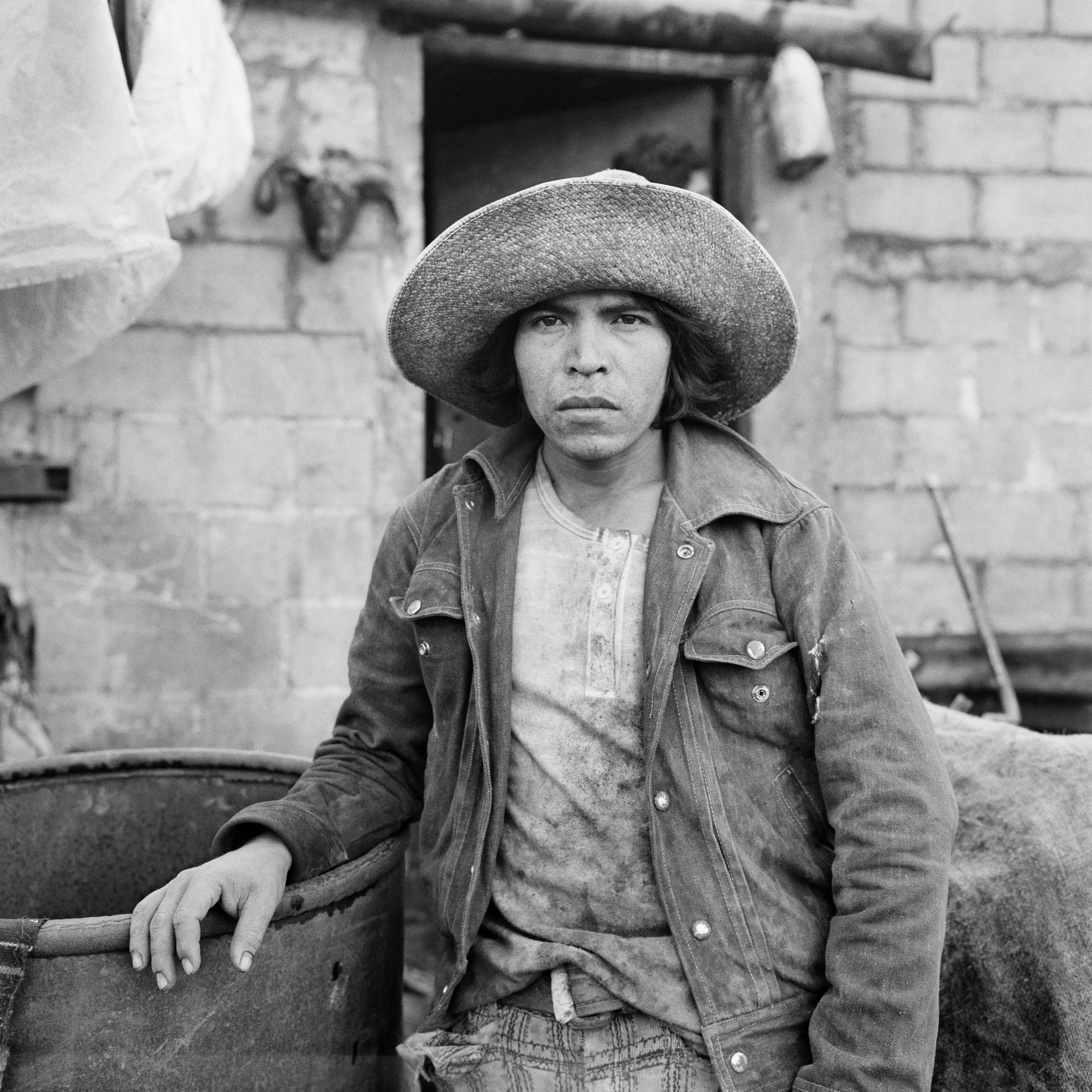A Guatemalan laborer stands near his temporary home along the Guatemalan-Mexican border in northwest Guatemala, January 1, 1983.