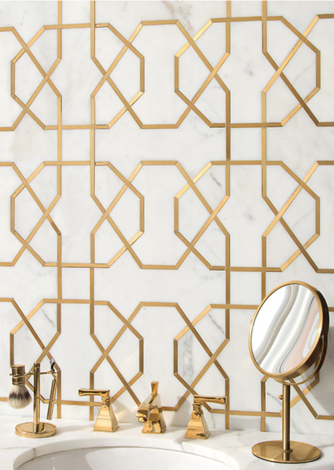 Collins, a waterjet stone mosaic, shown in honed Calacatta Gold and Brass, is part of the Trove™ collection for New Ravenna.