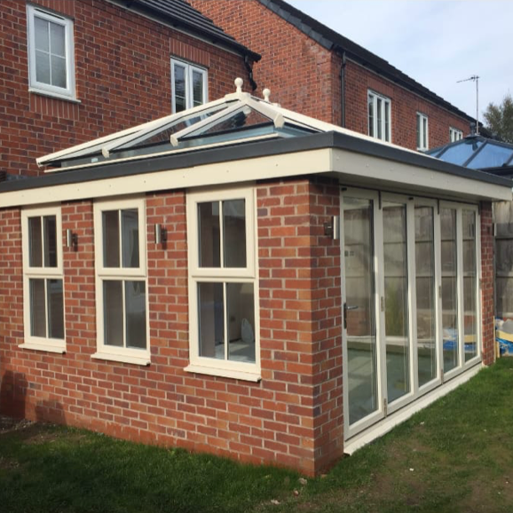 Red brick extension with aluminium custom windows and doors finished in 3 weeks for a repeat customer in Cheadle.