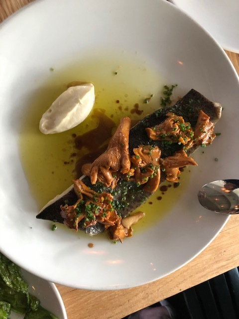 Trout poached in chanterelle mushroom