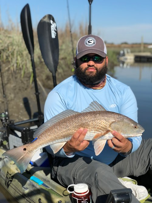 Levi Holding Beautiful Red Drum in Hobie